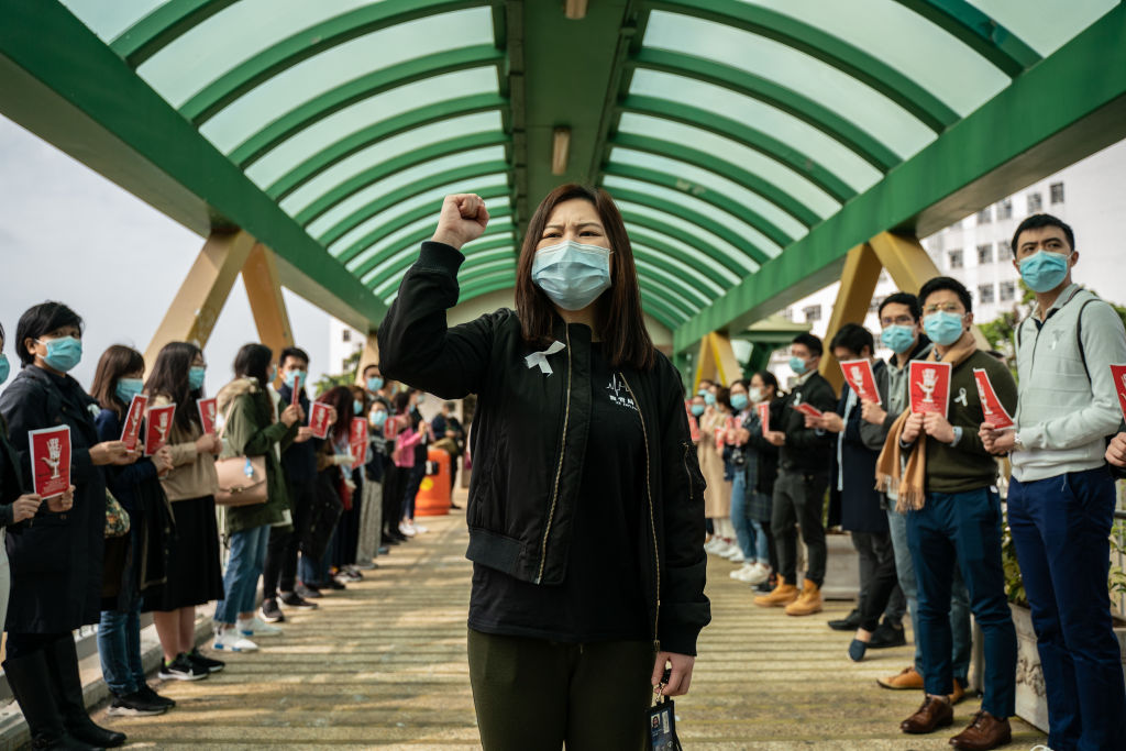 Medical workers stage a strike near Queen Mary Hospital in Hong Kong to demand the government shut the city's border with China to reduce the spread of the coronavirus on Feb. 3, 2020.