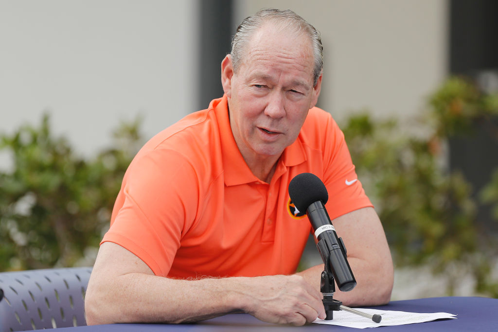 Houston Astros owner Jim Crane reads a prepared statement during a press conference at FITTEAM Ballpark of The Palm Beaches on February 13, 2020 in West Palm Beach, Florida.