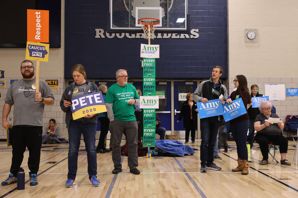 Supporters of Democratic presidential candidates former South Bend, Indiana Mayor Pete Buttigieg and Sen. Amy Klobuchar prepare to caucus for them in the gymnasium at Roosevelt High School in Des Moines, IA on Feb. 3, 2020.
