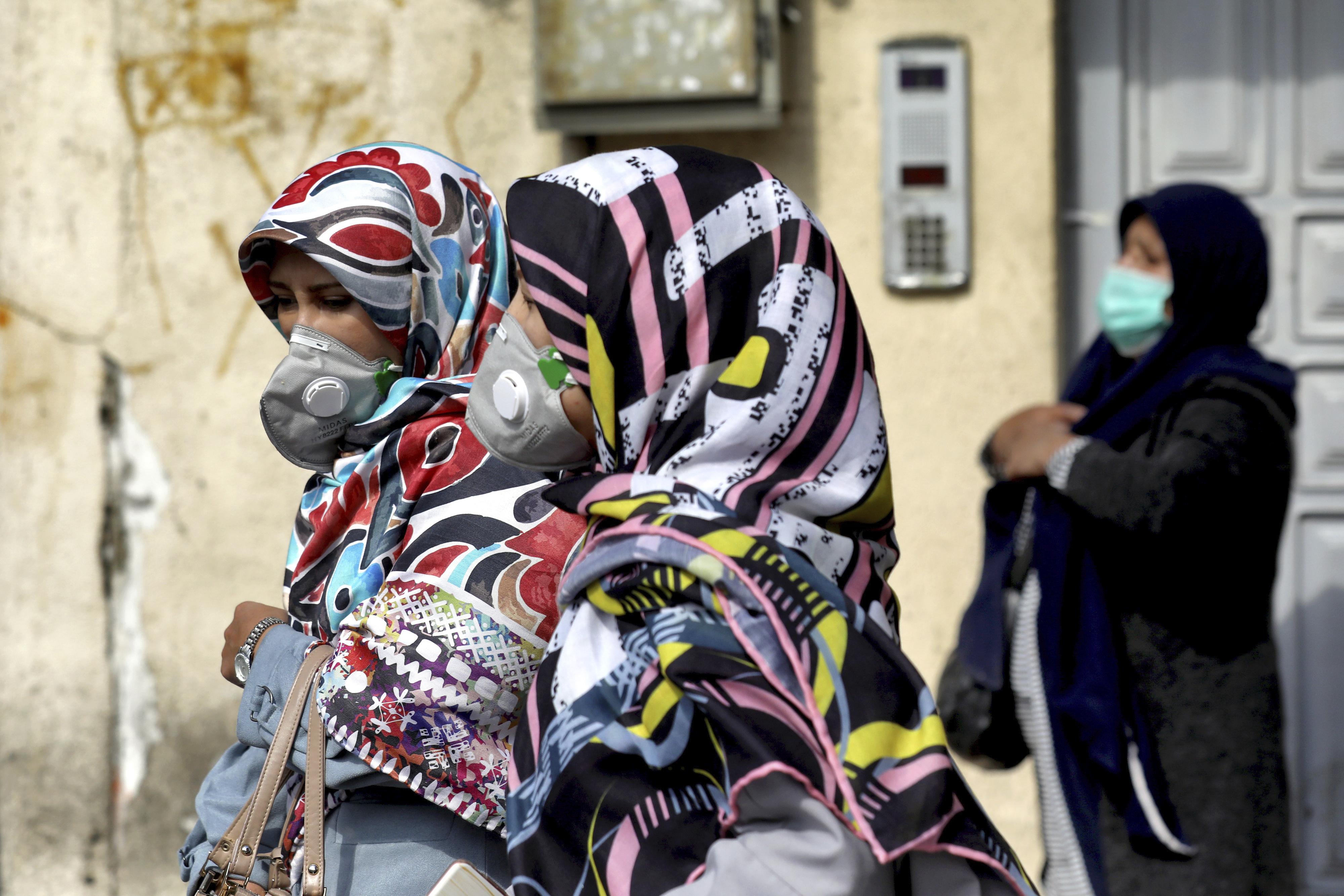 People wear masks to help guard against the Coronavirus in downtown Tehran, Iran, on Feb. 23, 2020.