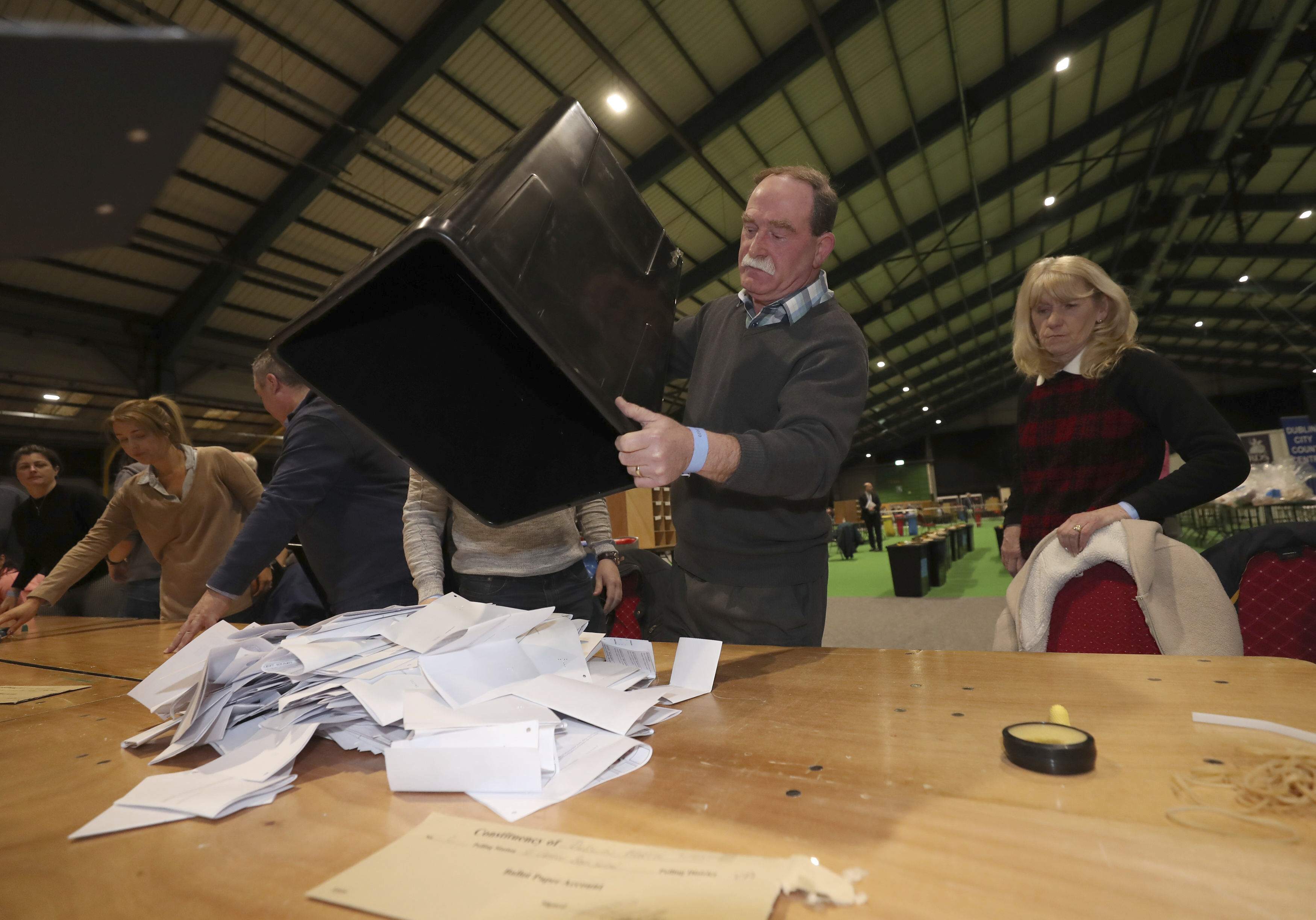 Ballot boxes are opened at the start of the Irish General Election count in Dublin, on Feb. 9, 2020.