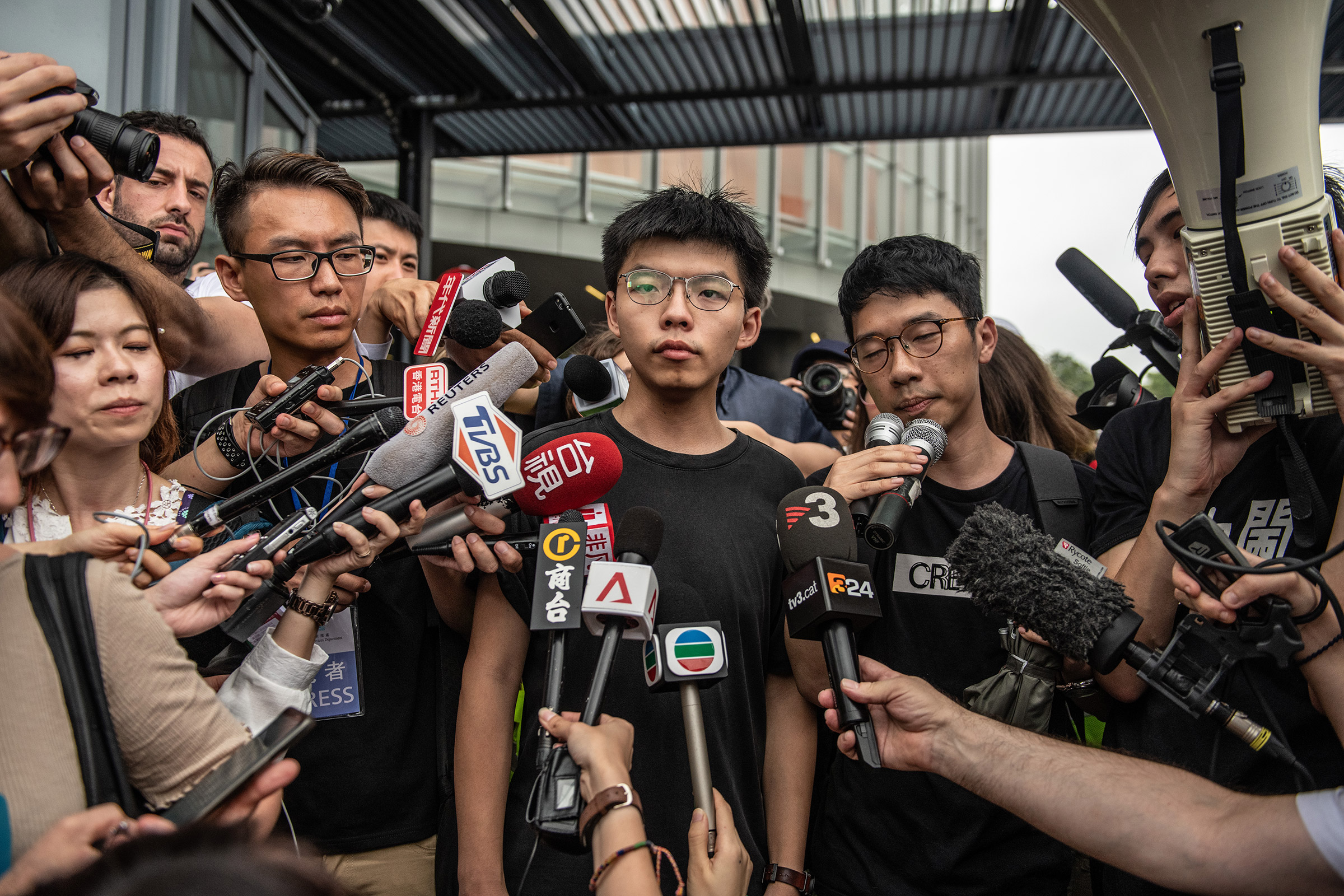 Pro-democracy activist Joshua Wong speaks to the media outside the Legislative Council shortly after being released from prison on June 17, 2019 in Hong Kong.