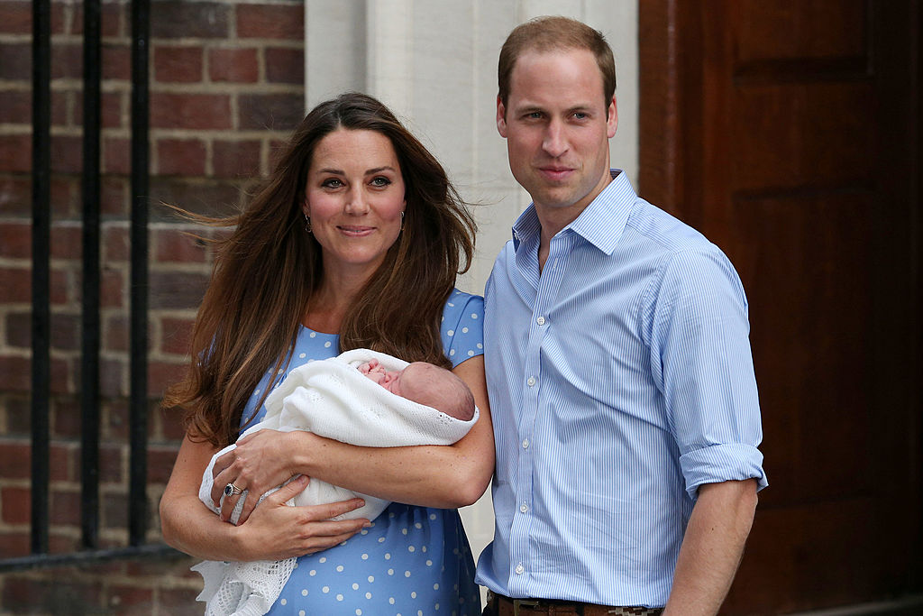 Prince William, Duke of Cambridge and Catherine, Duchess of Cambridge leave the Lindo Wing of St Mary's Hospital with their newborn son on July 23, 2013 in London, England.