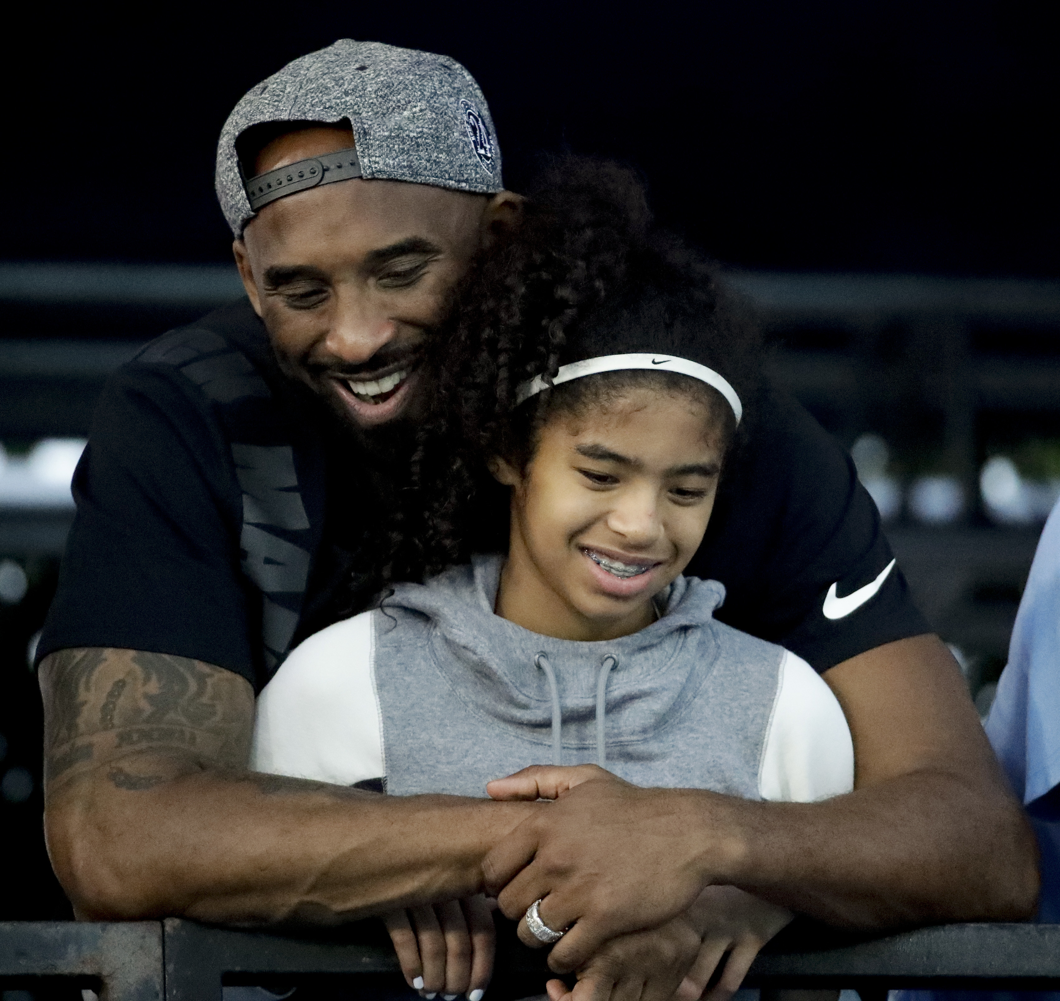 FILE - In this July 26, 2018, file photo former Los Angeles Laker Kobe Bryant and his daughter Gianna watch during the U.S. national championships swimming meet in Irvine, Calif.