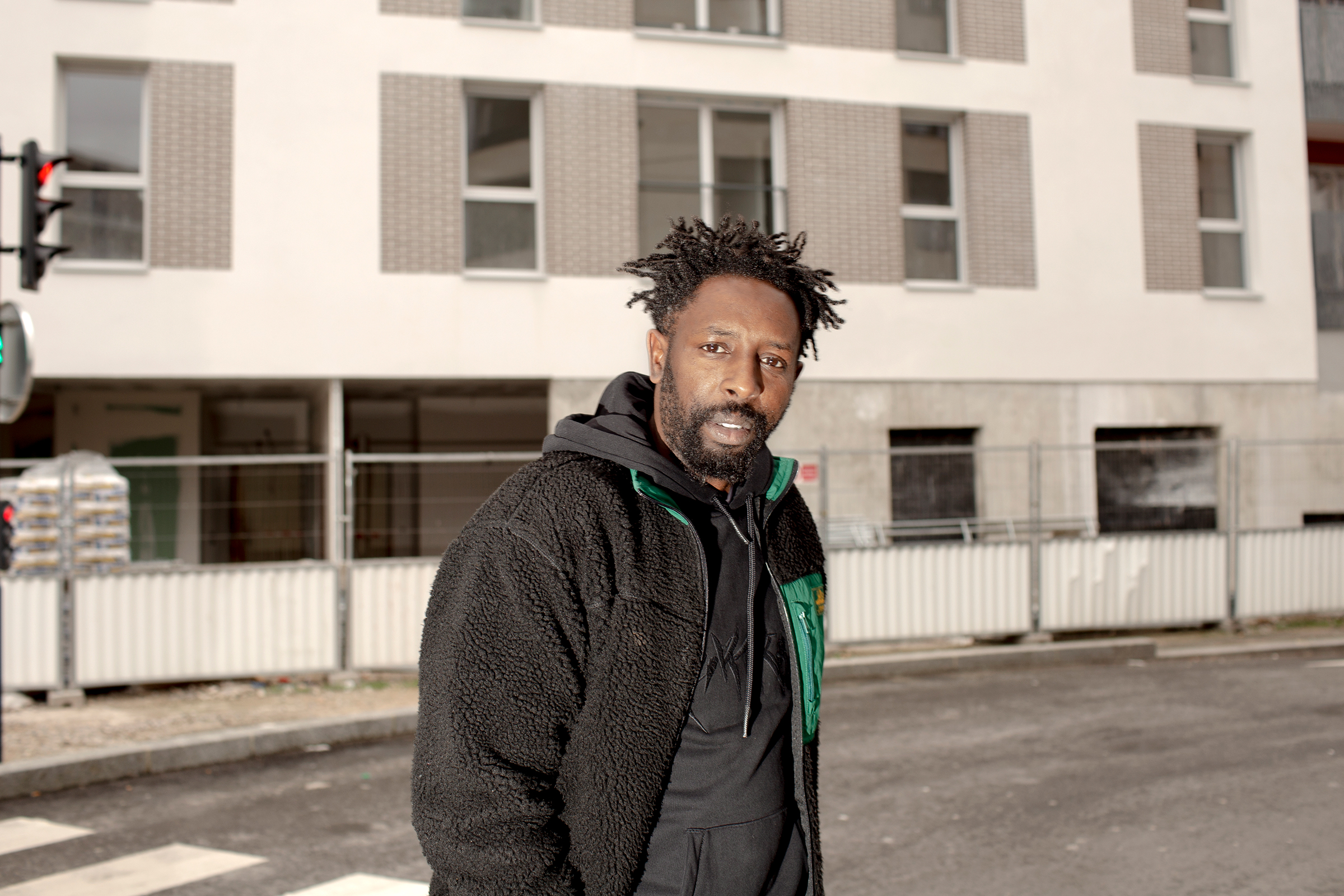 Ladj Ly, director of 'Les Misérables,' in Montfermeil, in the eastern suburbs of Paris, on Feb. 3.  There is Paris, and there are the banlieues, and they are two worlds apart,  Ly says.  We have been abandoned by the public system.