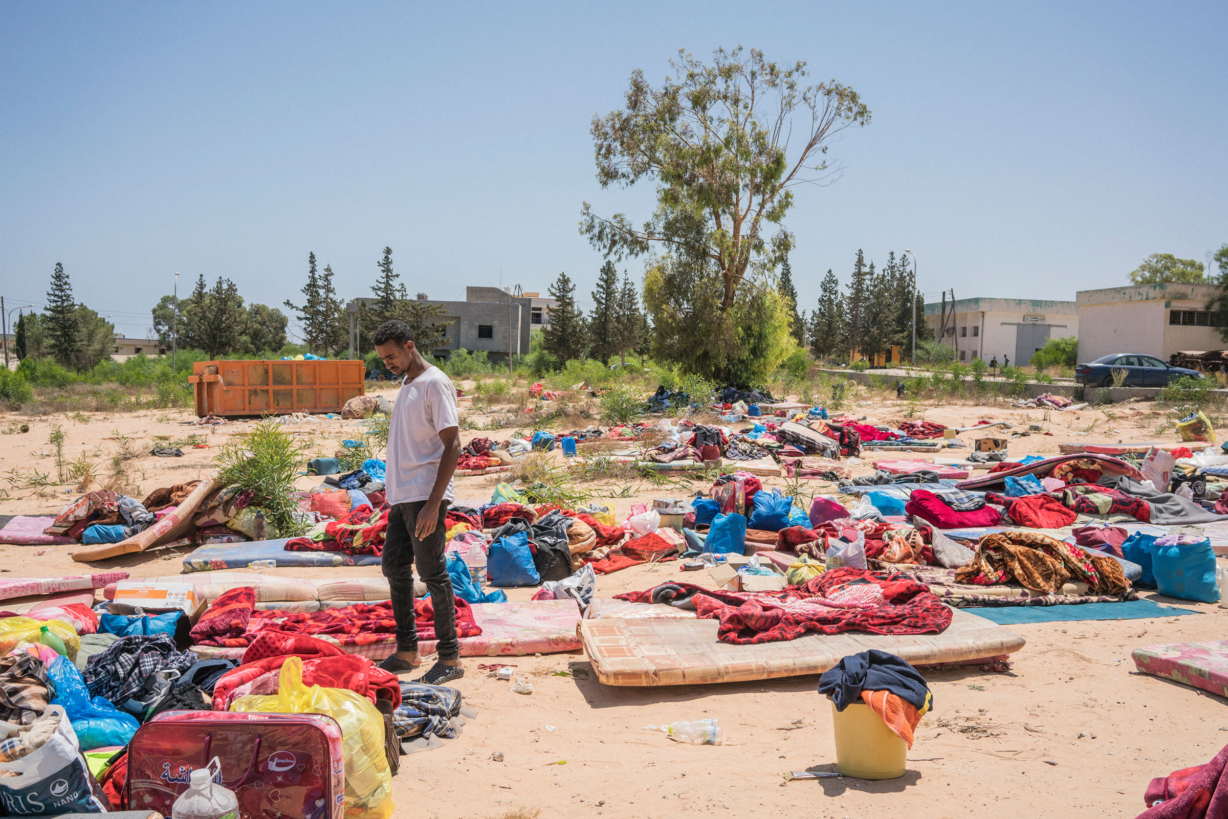 A man stands near damaged belongings after an airstrike hit a detention center, killing 53 people and injuring about 130 people, near Tripoli on July 3, 2019.