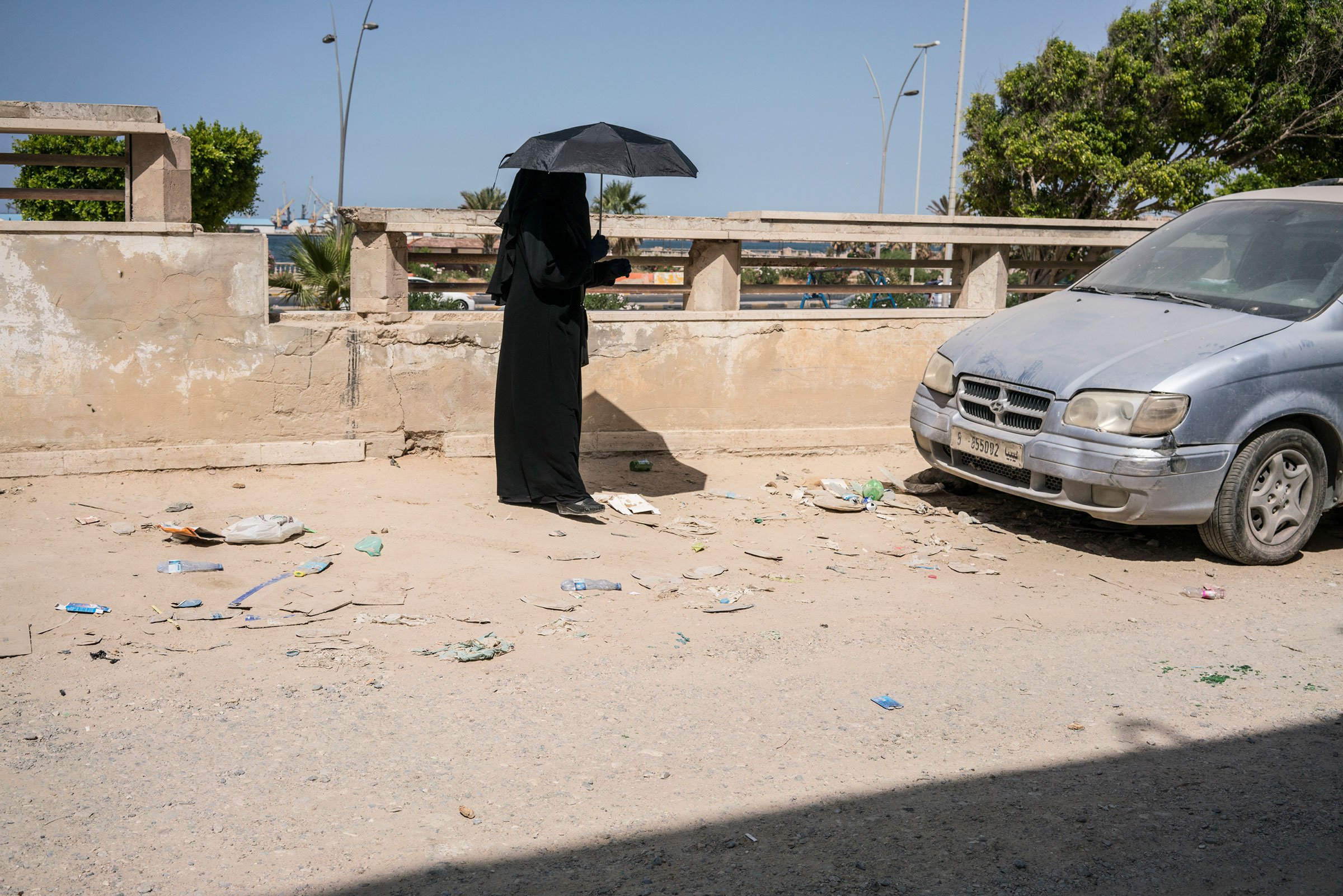 A woman on a road near the old city in Tripoli on July 5, 2019.