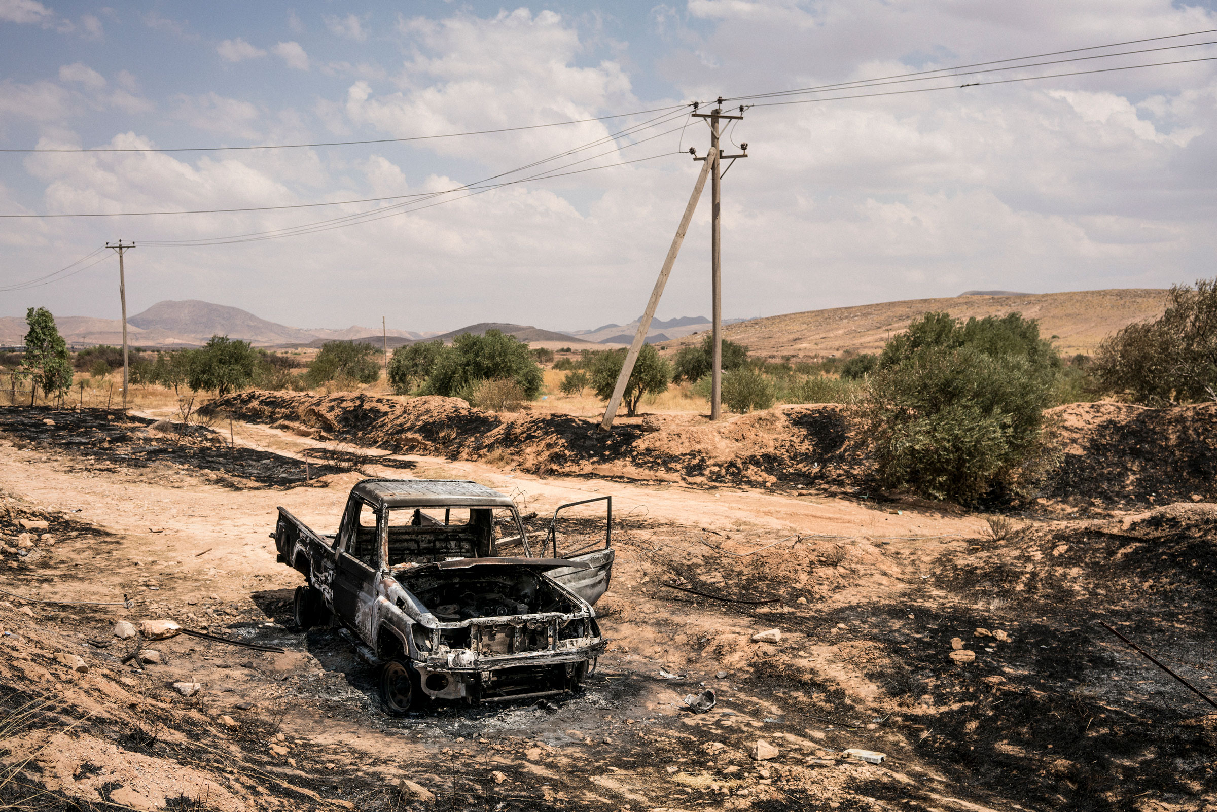 A vehicle burned during fighting in northwestern Gharyan on June 28, 2019.