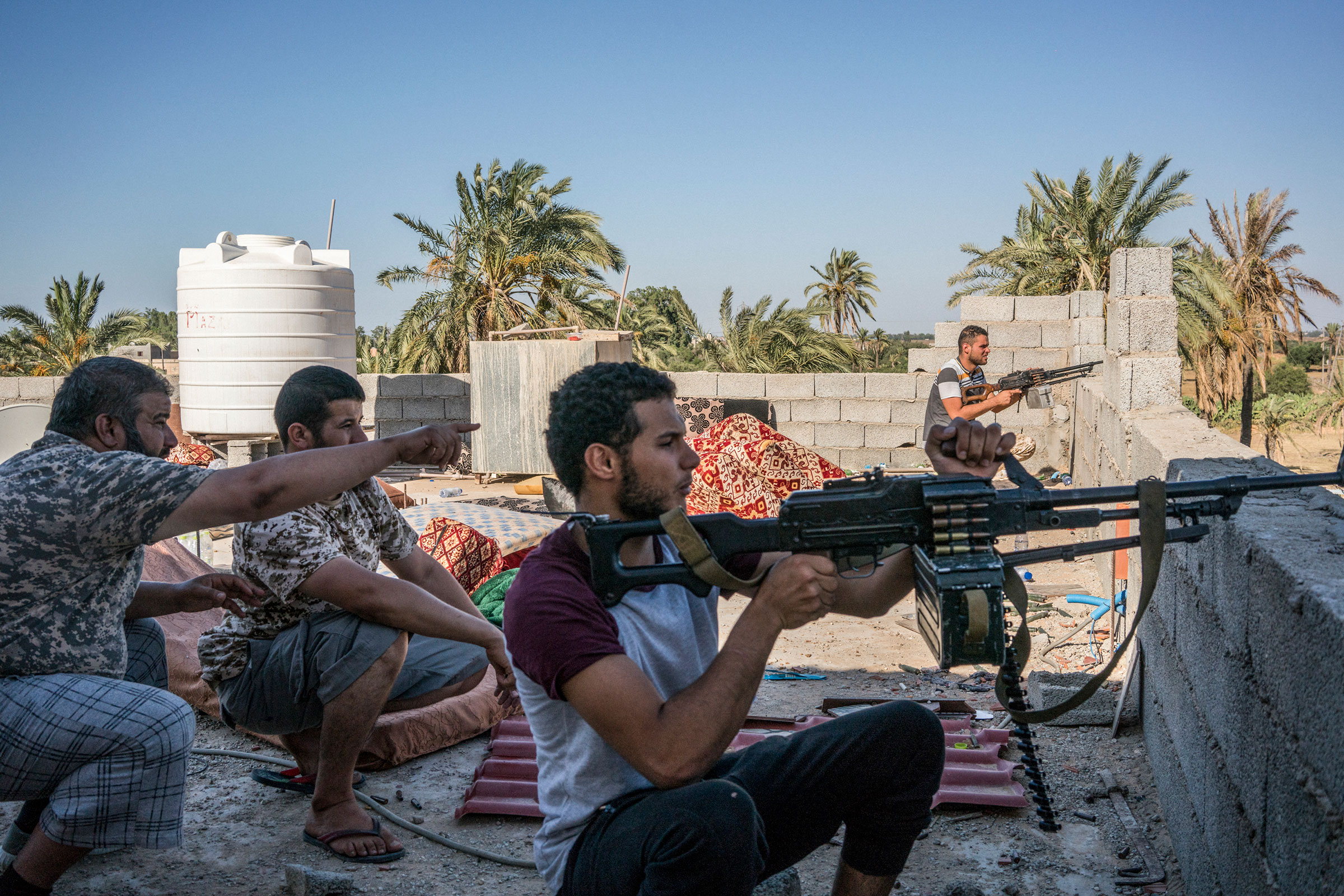 Fighters loyal to the Government of National Accord (GNA) spot positions of fighters loyal to Haftar on the international airport front line in Tripoli on July 4, 2019.