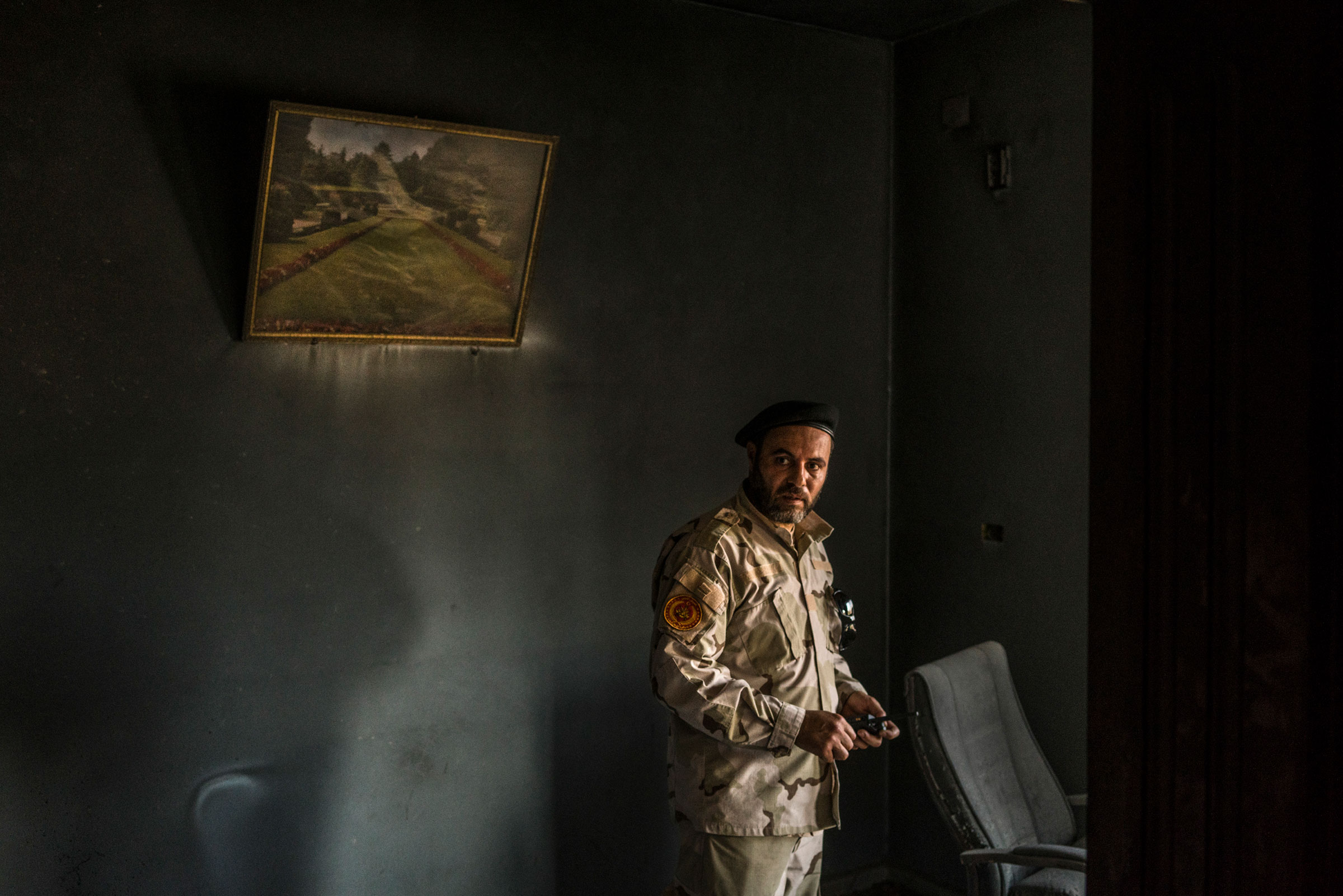 A fighter loyal to the GNA inside a building partially burned during a fight on the Yarmouk front line in Tripoli on July 1, 2019.