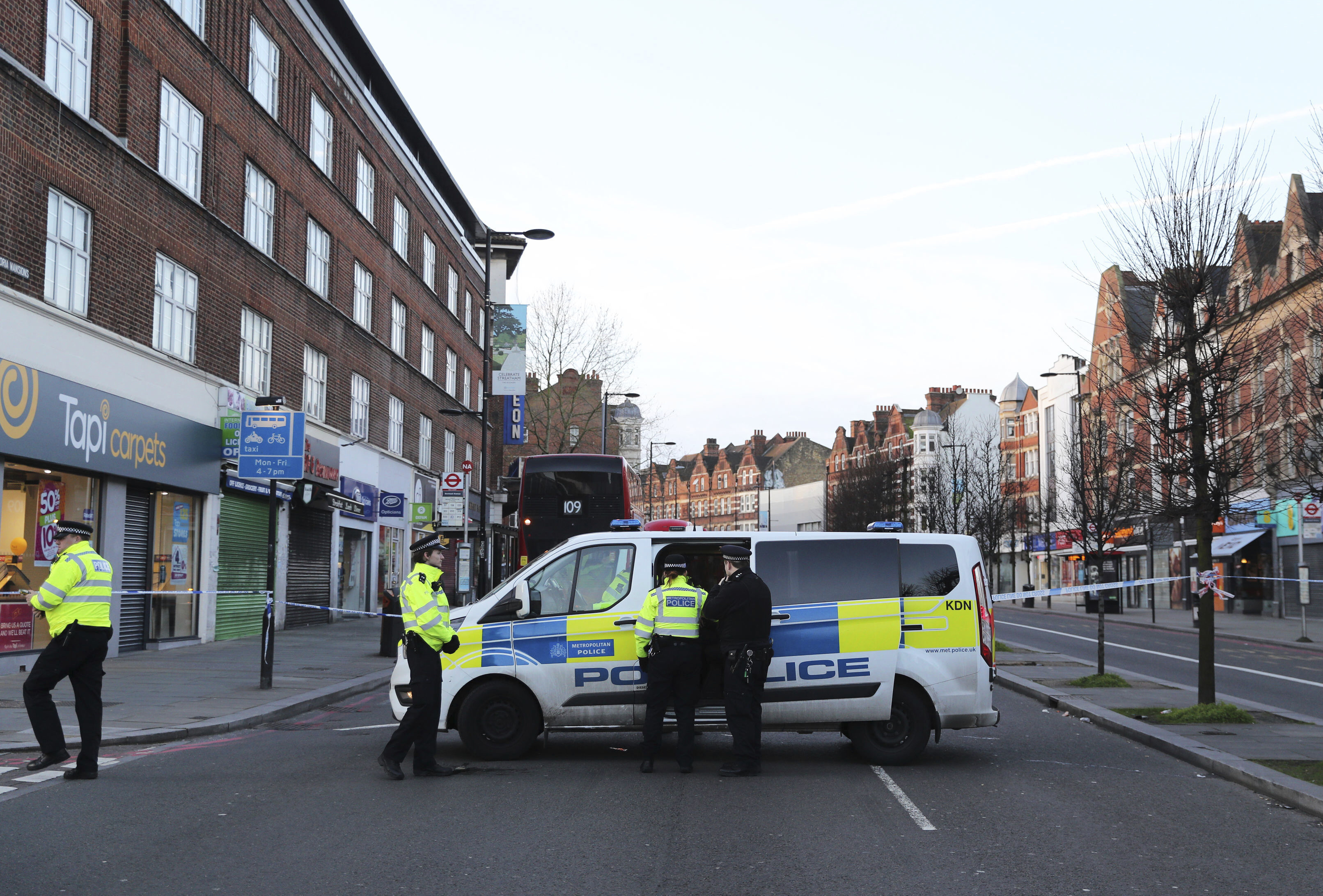Police continue to secure the scene following a terror stabbing attack in the Streatham area of south London Monday Feb. 3, 2020.