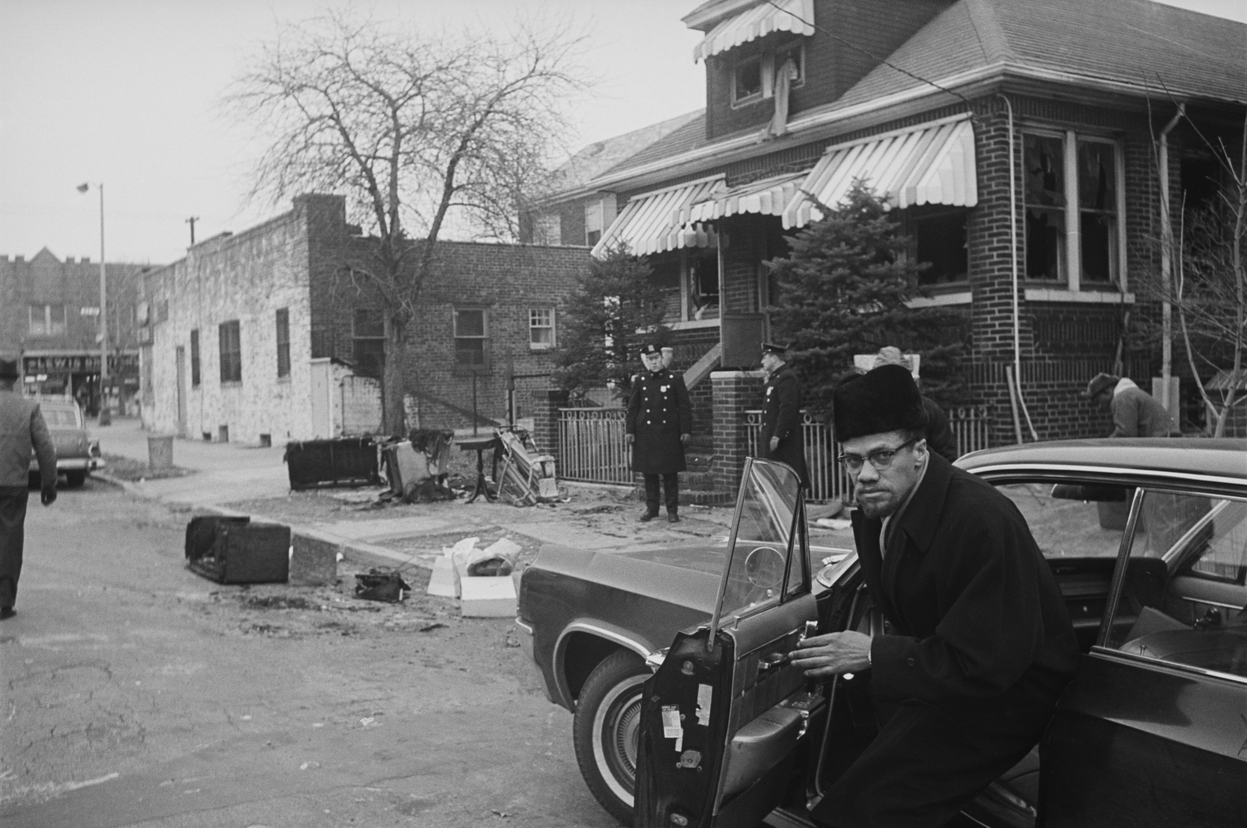 Malcolm X outside his house, which had been firebombed the night before, on Feb. 15, 1965.