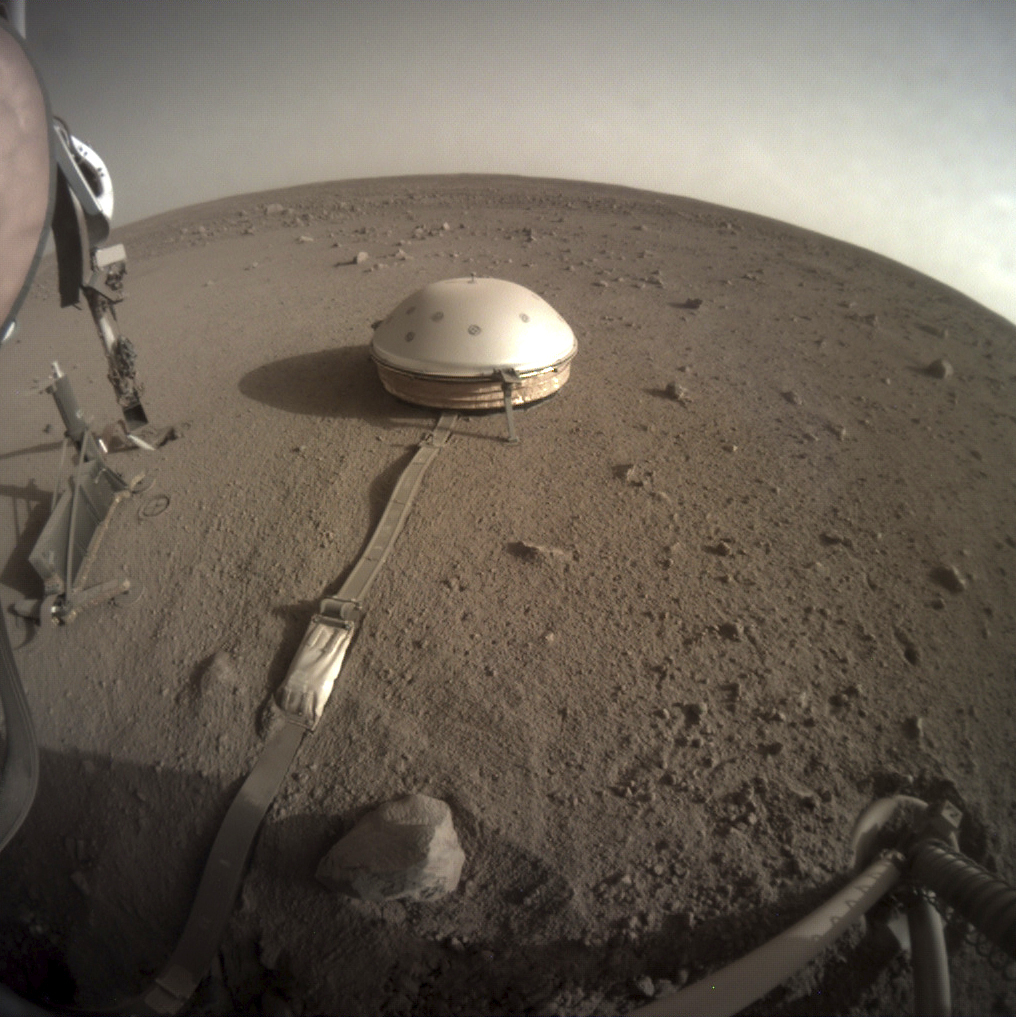 This Feb. 18, 2020 photo made available by NASA shows the InSight lander's dome-covered seismometer, known as SEIS, on Mars. On Feb. 24, 2020, scientists reported that the spacecraft has detected hundreds of quakes and even aftershocks that are regularly jolting the red planet.