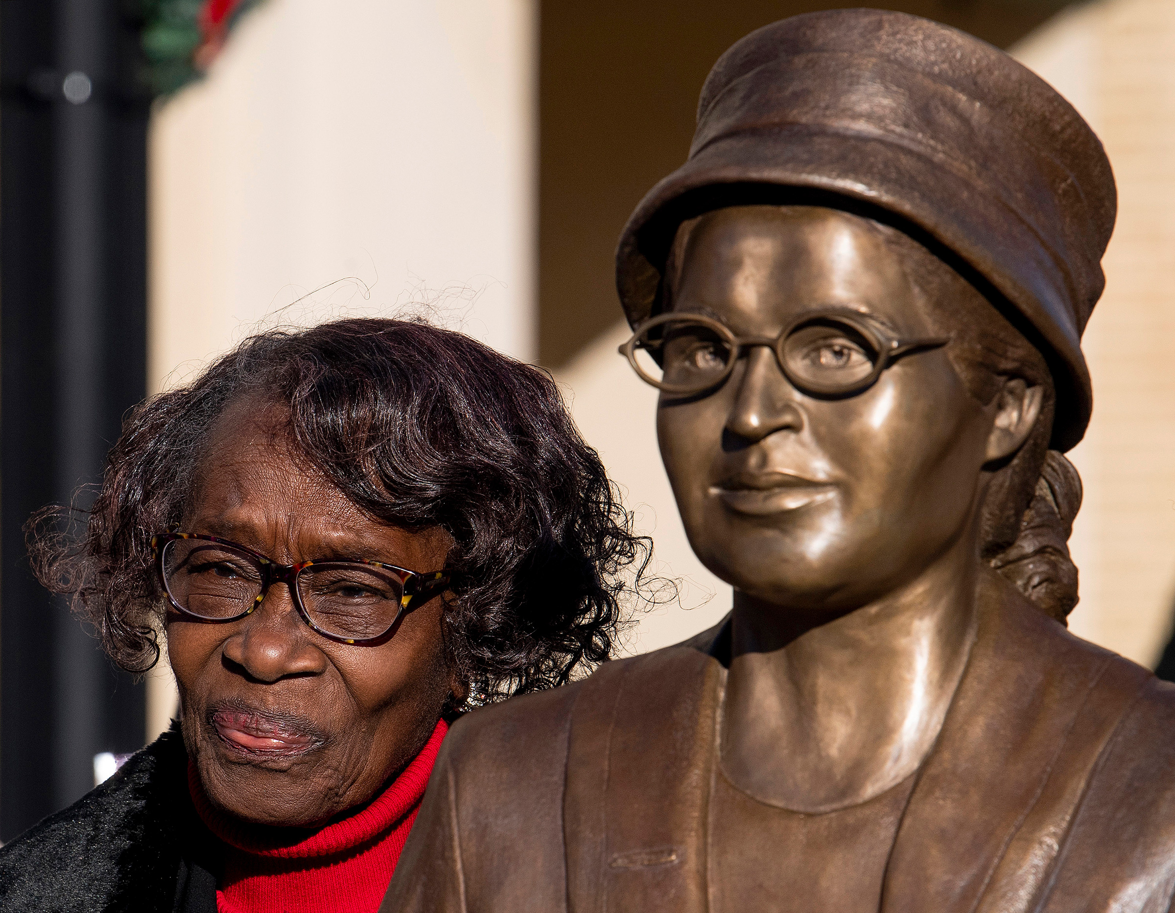 Mary Louise Smith-Ware, a plaintiff in the Browder vs. Gayle case that led to the desegregation of buses in Montgomery, stands beside the Rosa Parks statue after its unveiling event in downtown Montgomery, Ala., on Dec. 1, 2019, the anniversary of Parks being arrested for not giving up her seat on a city bus.