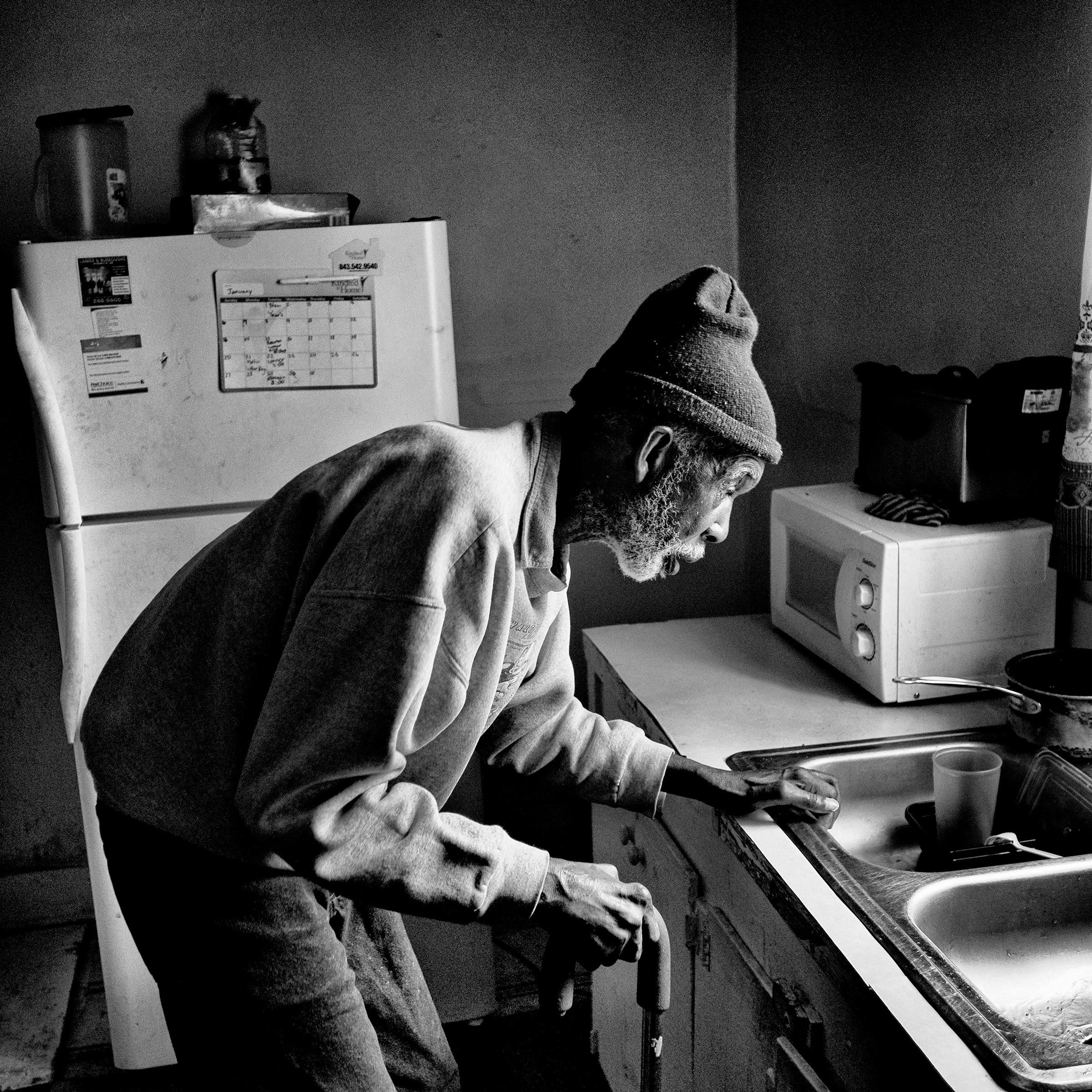 Saint Joseph Johnson, who died in January, in his kitchen last year