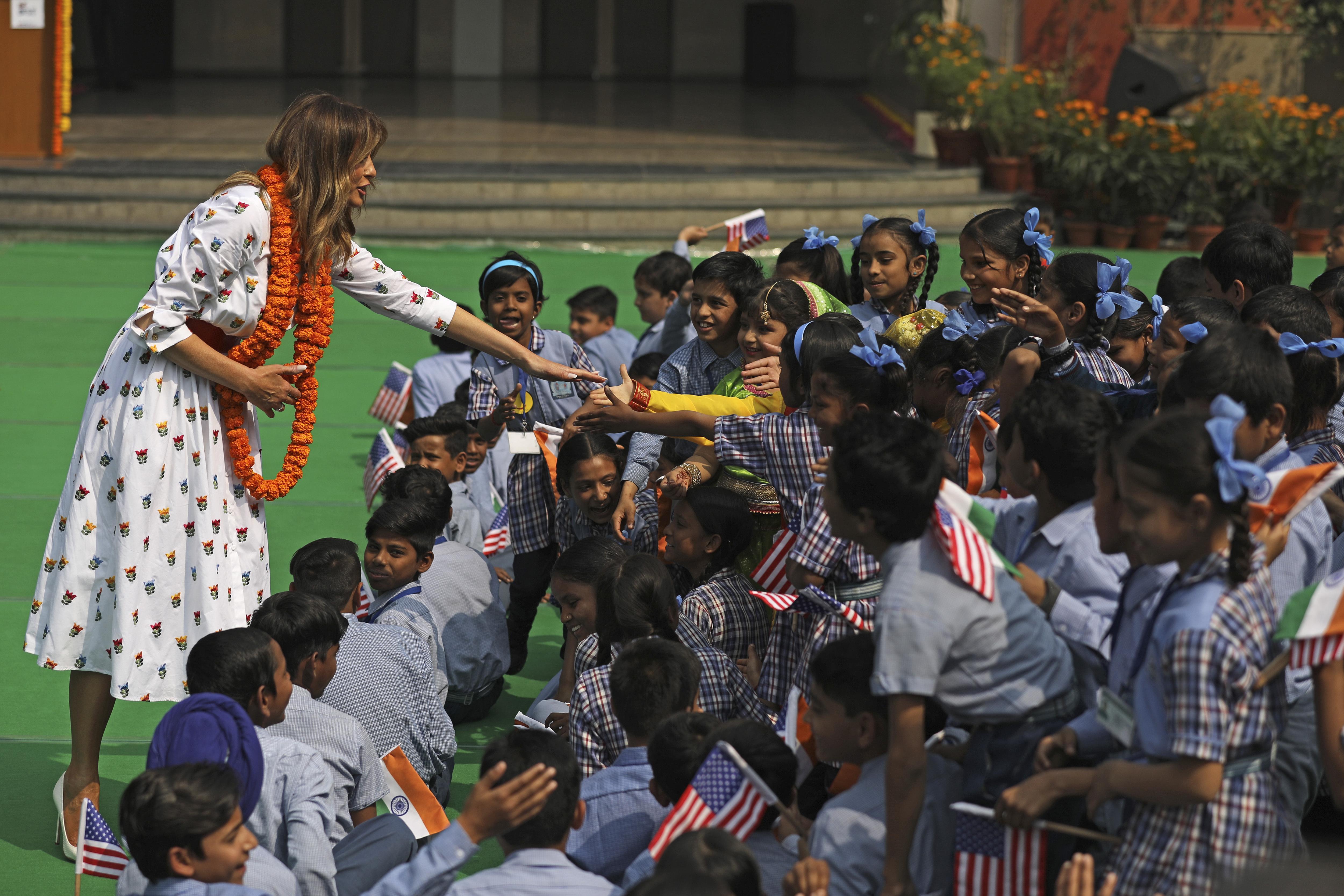 U.S. first lady Melania Trump shakes hand with children at Sarvodaya Co-Educational Senior Secondary School in New Delhi, India, on Feb. 25, 2020.