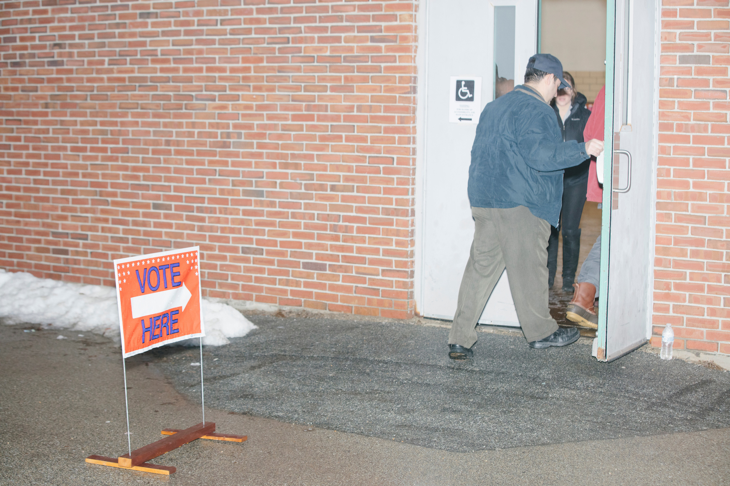 People arrive to vote in the New Hampshire Presidential Primary at Fair Grounds Junior High School in Nashua, N.H., on Feb. 11, 2020.