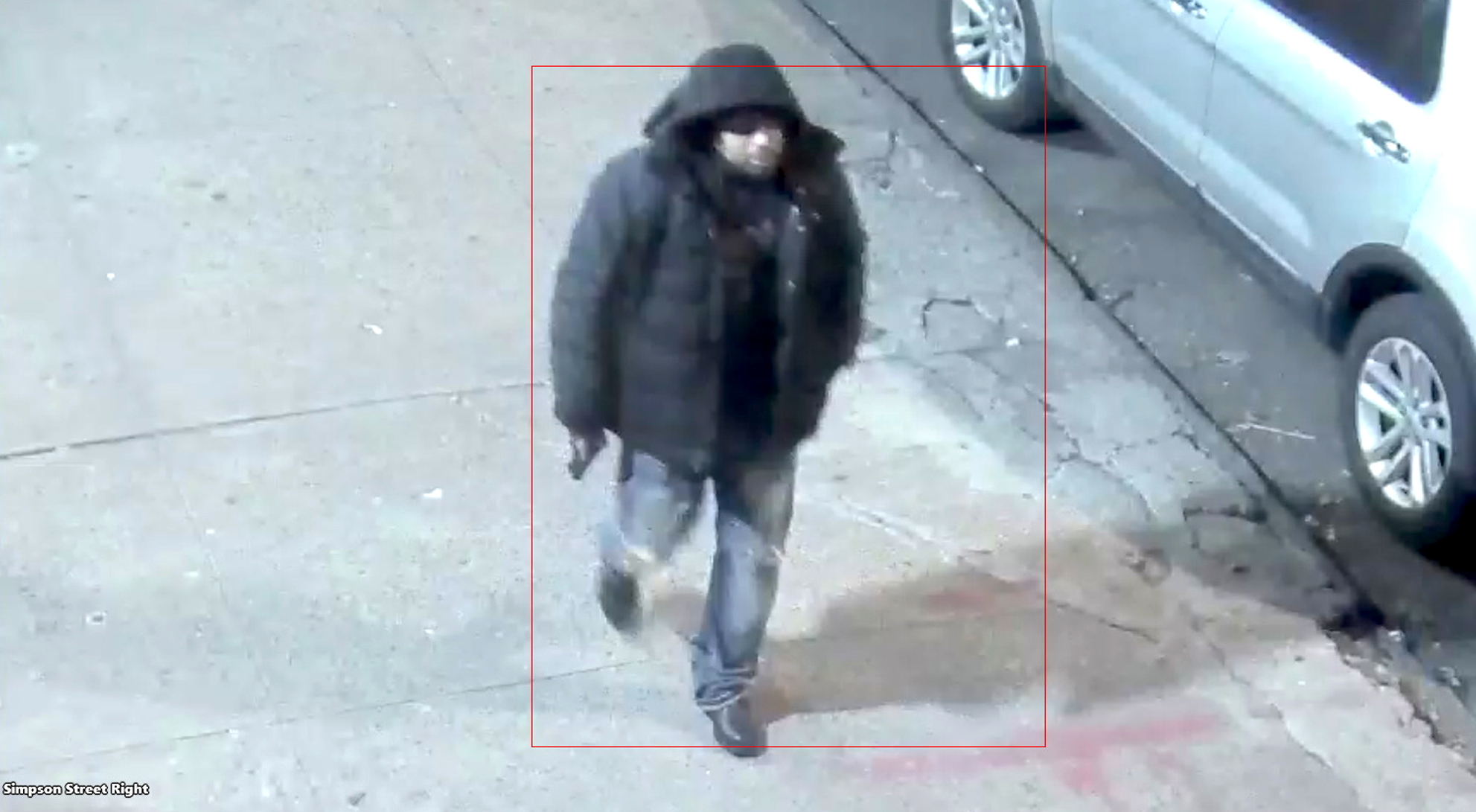 In this image taken from video provided by the New York Police Department a man, who the NYPD is seeking the public's assistance in identifying in connection to a police involved shooting, walks down a street on Saturday, Feb. 8, 2020, in New York.