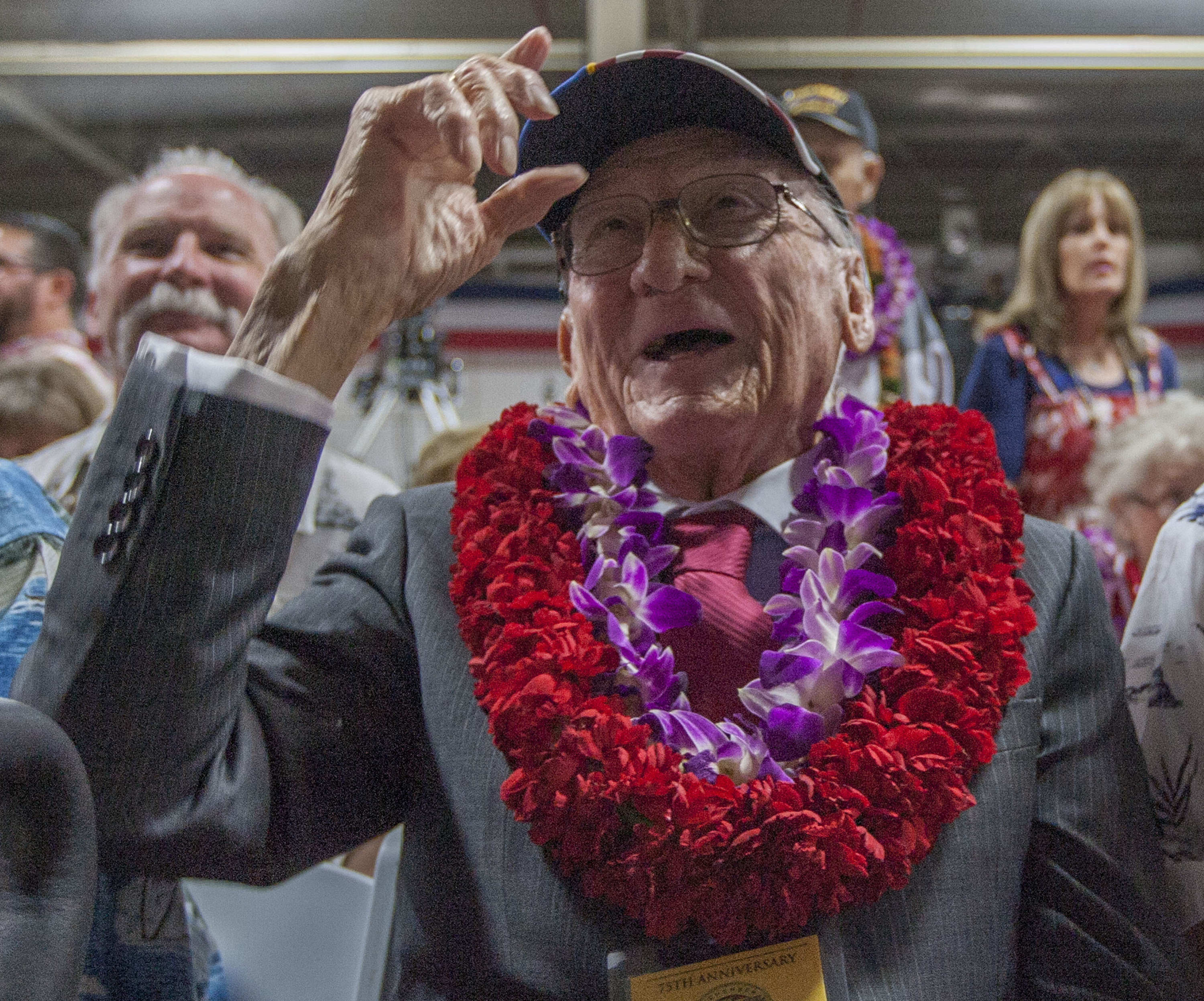 In this Dec. 7, 2016, file photo, Donald Stratton, center, a USS Arizona survivor, acknowledges a friend at Kilo Pier next to the World War II Valor in the Pacific National Monument at Joint Base Pearl Harbor-Hickam in Honolulu. Stratton passed away in his sleep at his Colorado Springs home Saturday, Feb. 16, 2020 with his family in attendance. Stratton was one of the survivors of the Dec. 7, 1941, Japanese aerial attack on the U.S. Navy base at Pearl Harbor in Hawaii that killed 1,100 Arizona crew members.