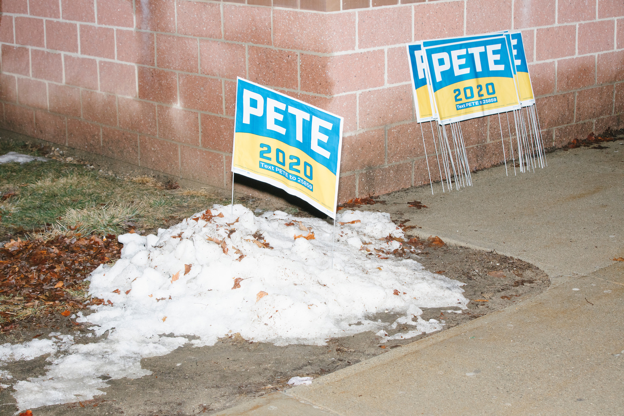 Campaign signs for Democratic presidential candidate and former South Bend, Ind., mayor Pete Buttigieg stand outside Exeter High School before a campaign rally in Exeter, N.H., on Feb. 10, 2020.