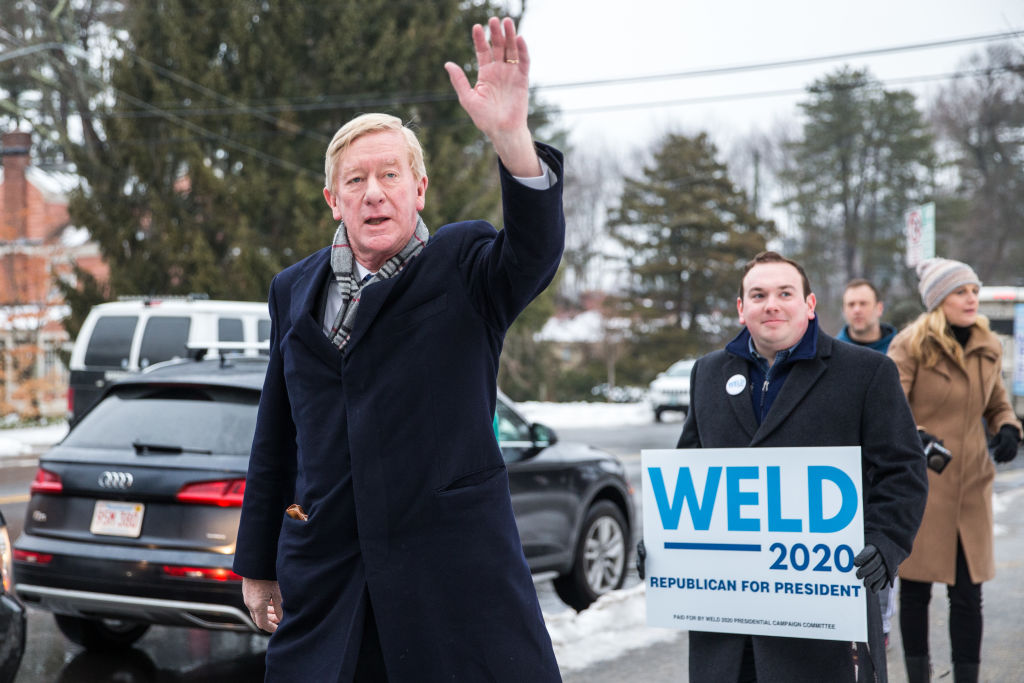 Republican presidential candidate and former Massachusetts Governor Bill Weld waves to voters at the Webster Elementary School during the presidential primary on Feb. 11, 2020 in Manchester, New Hampshire.