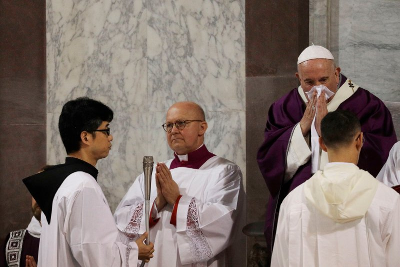 FILE - In this Feb. 26, 2020 file photo Pope Francis wipes his nose during a Mass on Ash Wednesday  inside the Basilica of Santa Sabina in Rome.