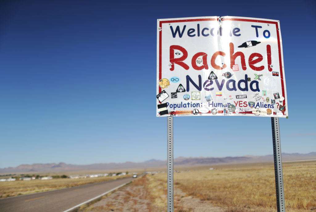 A town sign is posted, mentioning aliens, during the 'Storm Area 51' spinoff event 'Alienstock' on September 21, 2019 in Rachel, Nevada.