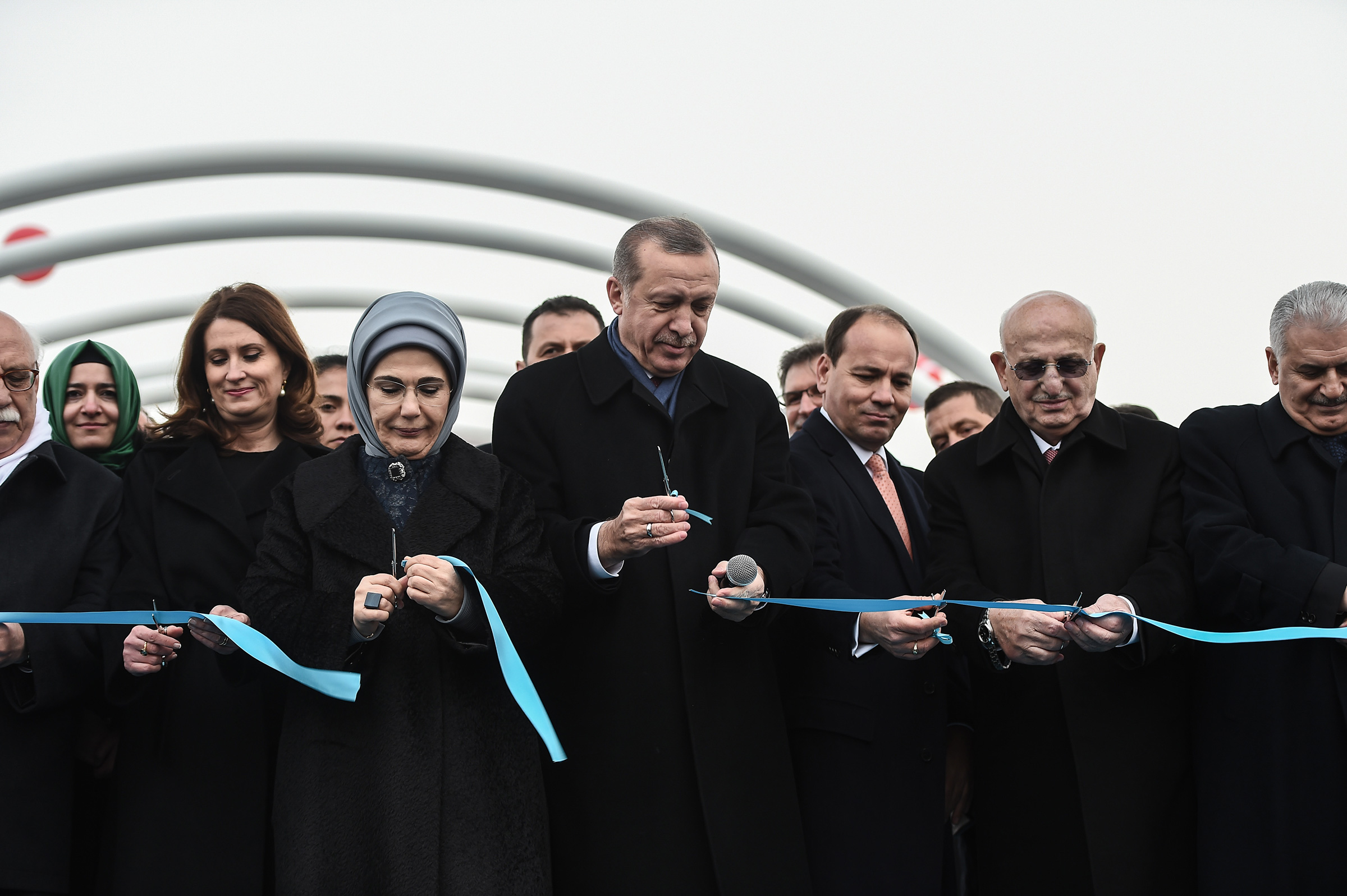 Turkish President Recep Tayyip Erdogan, center, with his wife Emine Erdogan by his side and Prime Minister Binali Yildirim, right, during the opening ceremony of a road tunnel underneath the Bosporus Strait in Istanbul in December 2016.