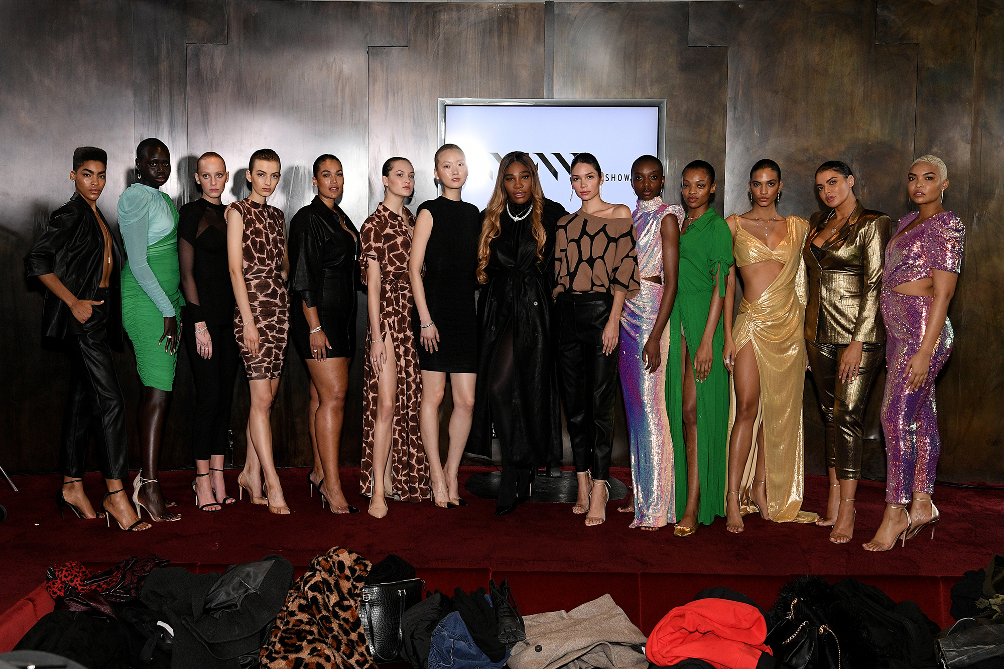 Designer Serena Williams poses with models for the S By Serena Presentation during New York Fashion Week (Photo by Dia Dipasupil/Getty Images)