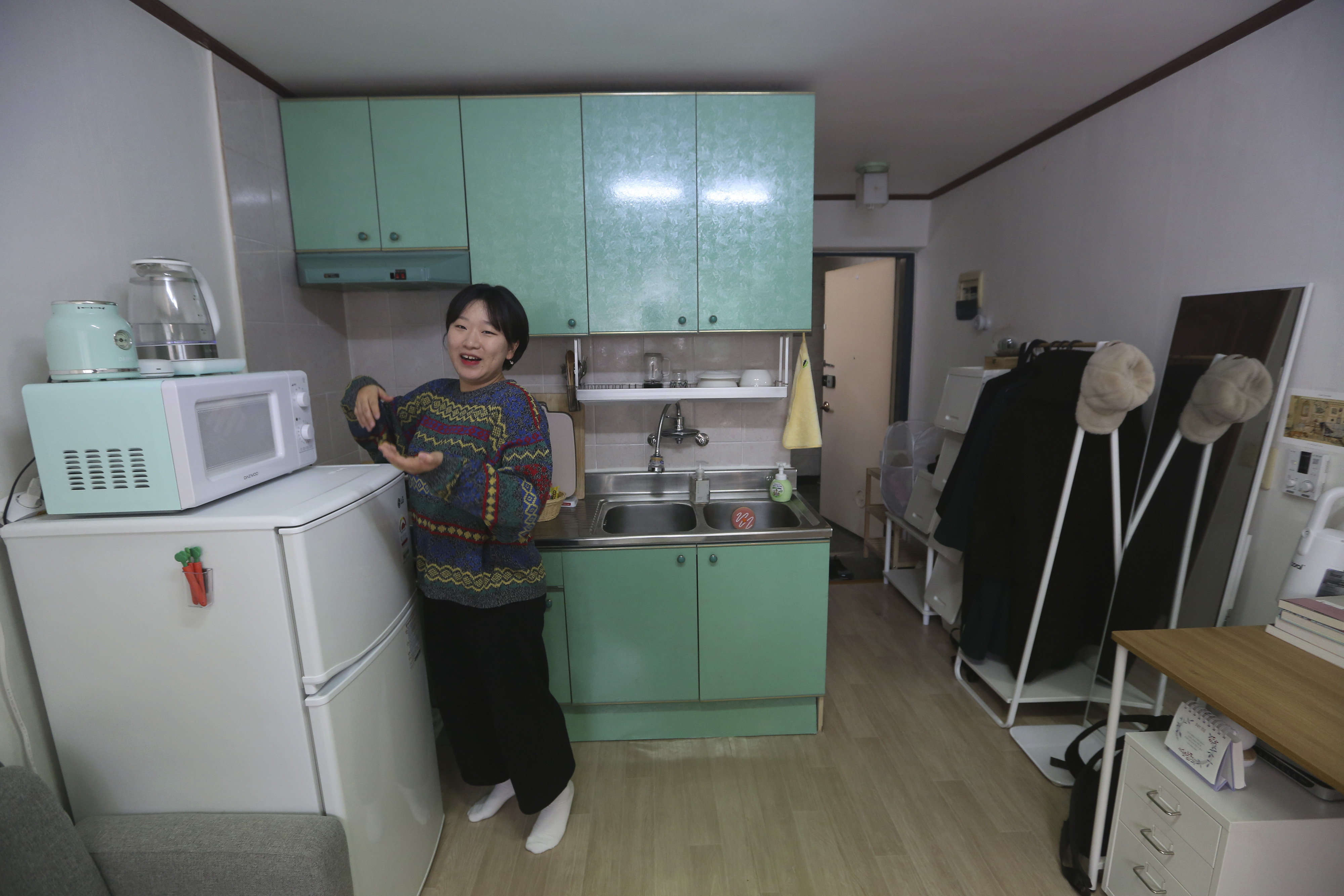 Kim Da-hye, a 29-year-old South Korean, talks about her semi-basement apartment in Seoul, South Korea, Saturday, Feb. 15, 2020.