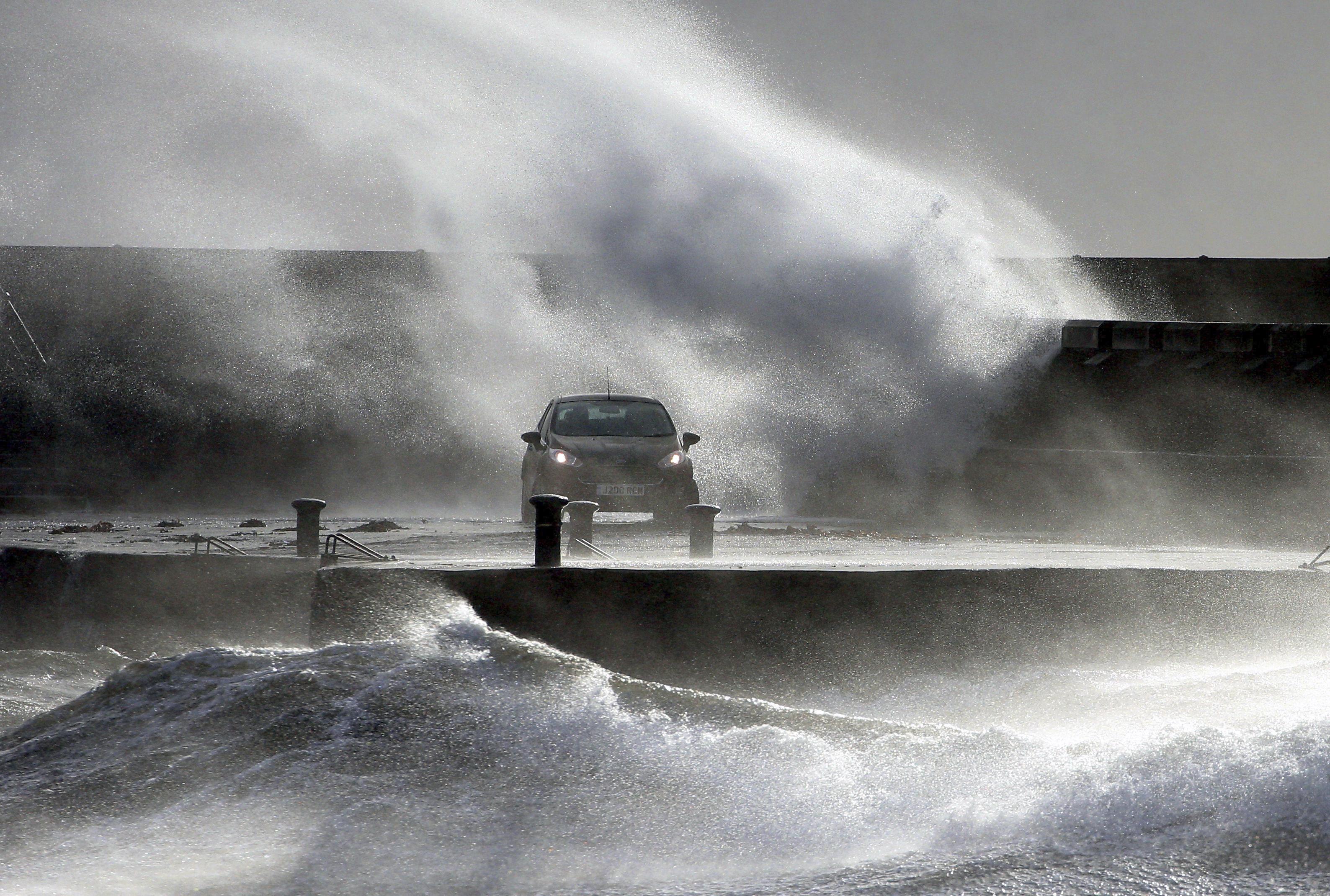 Waves lash the coast on the Ayrshire coast at Ardrossan, Scotland, on Feb. 9, 2020.