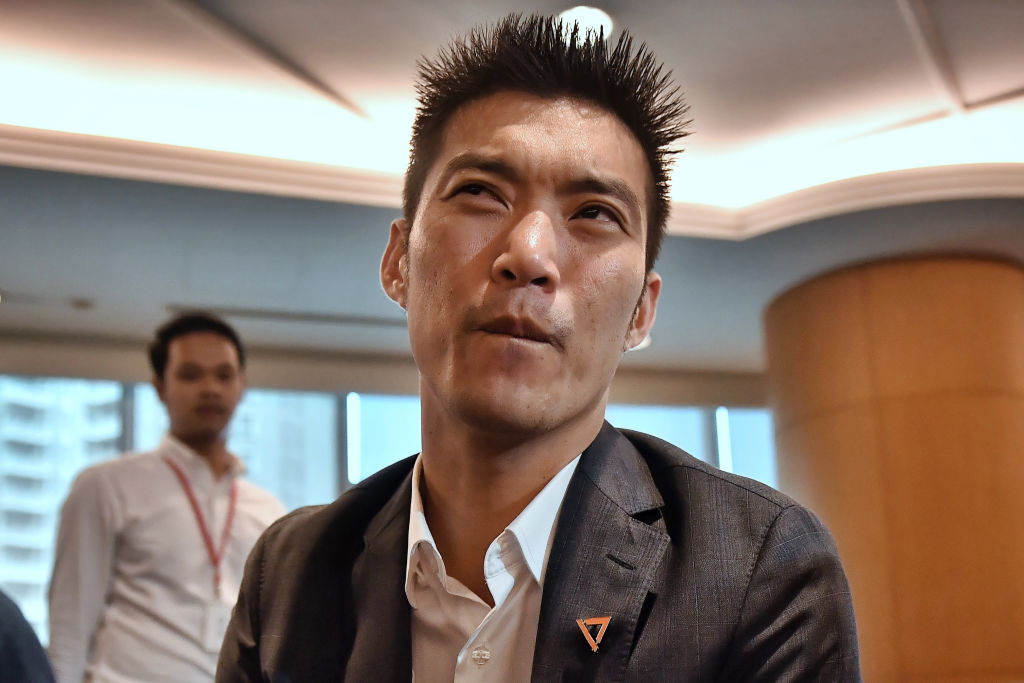 Future Forward Party leader Thanathorn Juangroongruangkit watches court proceedings with fellow members and MPs at the political partys headquarters in Bangkok on Feb. 21, 2020.