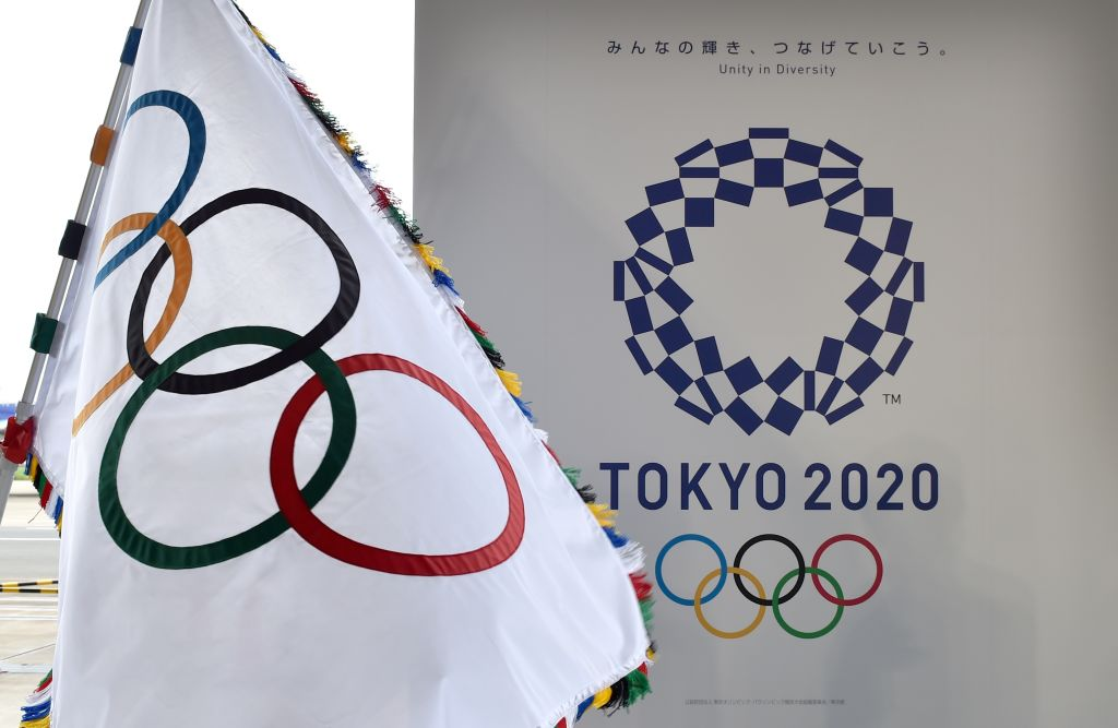 The Olympic flag and the logo of the Tokyo 2020 are displayed during the official flag arrival ceremony at the Tokyo's Haneda airport on Aug. 24, 2016.