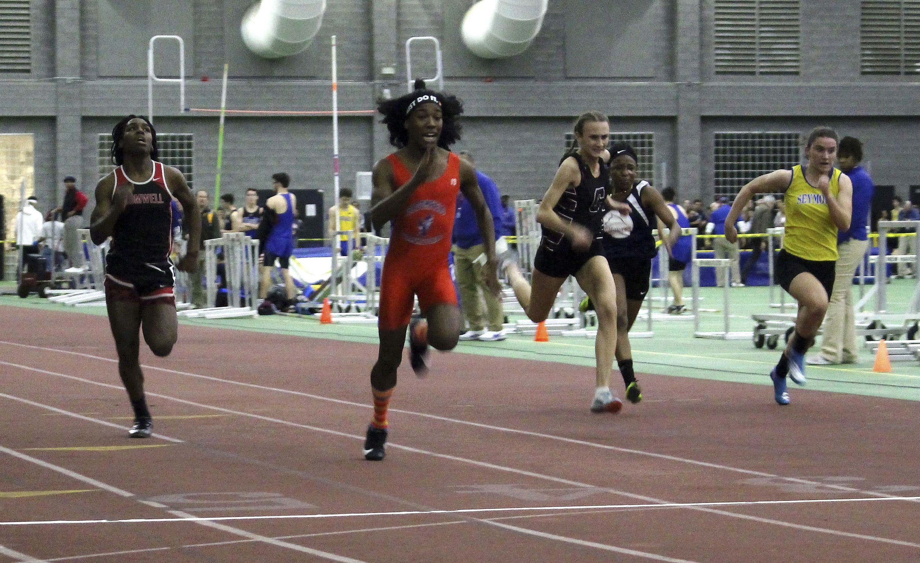 In this Feb. 7, 2019, file photo, Bloomfield High School transgender athlete Terry Miller, second from left, wins the final of the 55-meter dash over transgender athlete Andraya Yearwood, far left, and other runners in the Connecticut girls Class S indoor track meet at Hillhouse High School in New Haven, Conn.