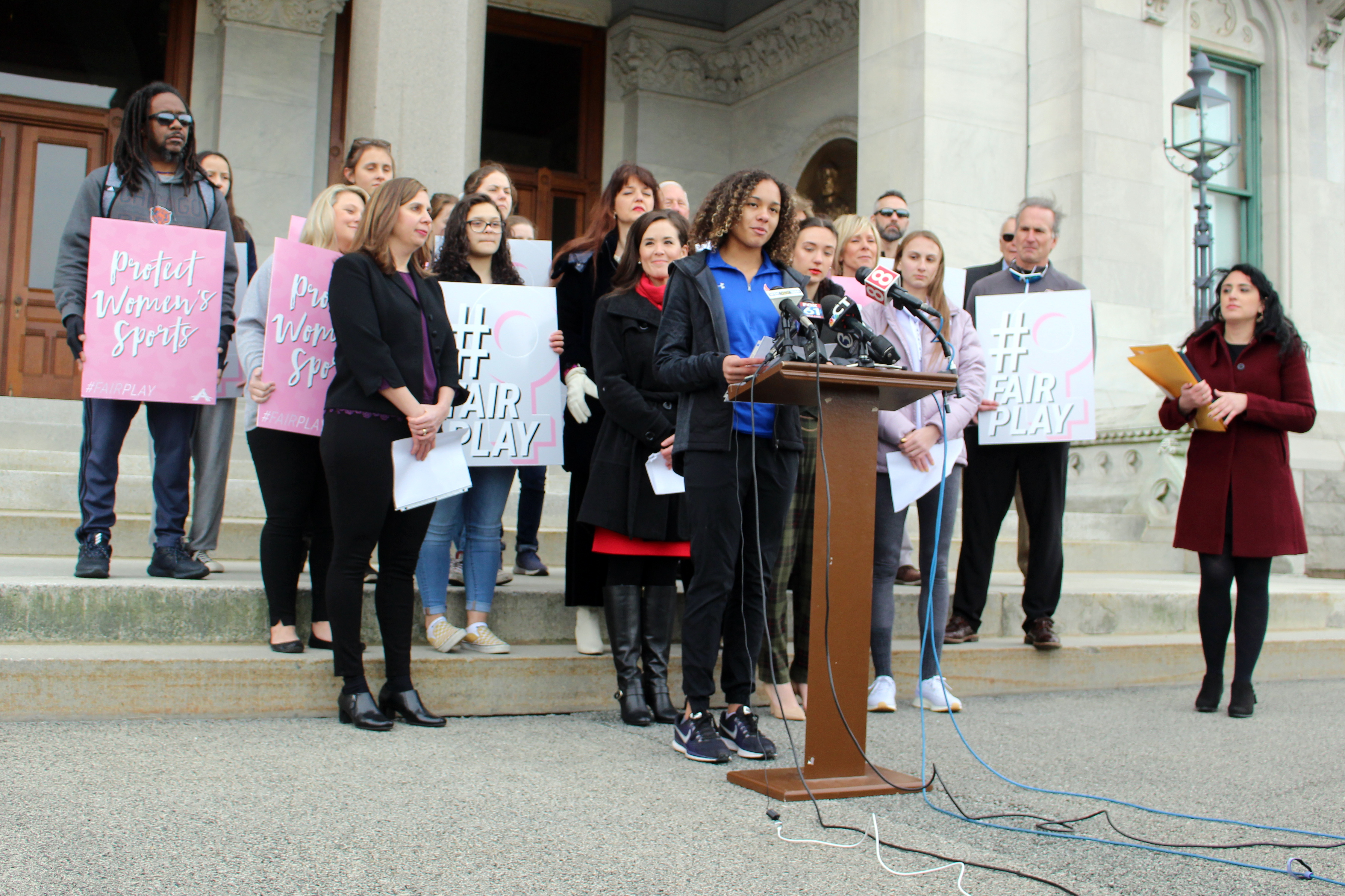 Danbury High School sophomore Alanna Smith speaks during a news conference at the Connecticut State Capitol in Hartford, Conn., Wednesday, Feb, 12, 2020. Smith, the daughter of former Major League pitcher Lee Smith, is among three girls suing to block a state policy that allows transgender athletes to compete in girls sports.
