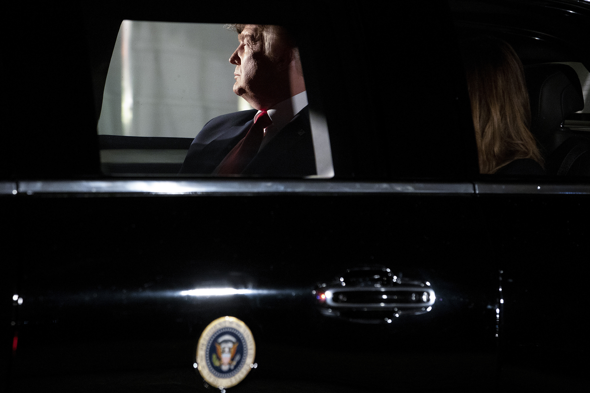 President Donald Trump sits in the presidential motorcade on the South Lawn of the White House on Feb. 4, 2020.