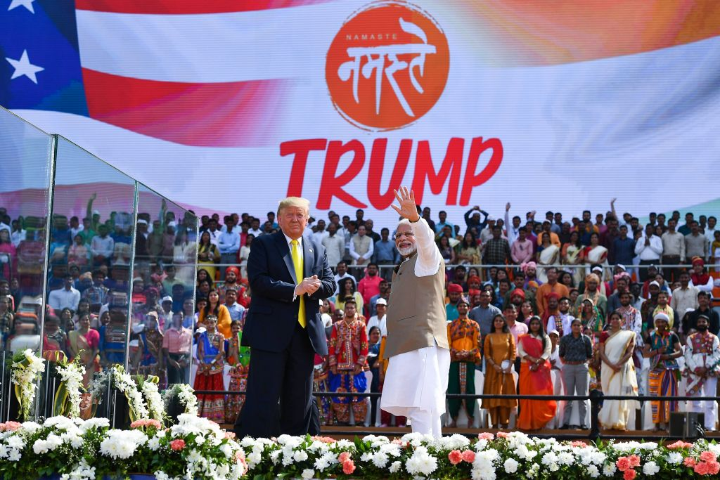 President Donald Trump looks on as India's Prime Minister Narendra Modi waves during 'Namaste Trump' rally at Sardar Patel Stadium in Motera, on the outskirts of Ahmedabad, on Feb. 24, 2020.