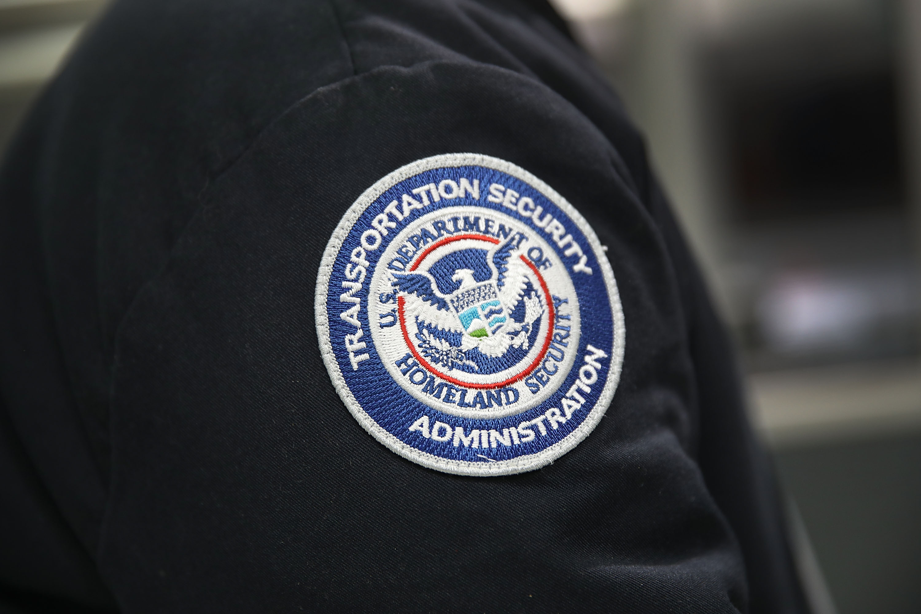 A patch is seen on the jacket of a Transportation Security Administration official on Oct. 24, 2017 in Miami, Florida.