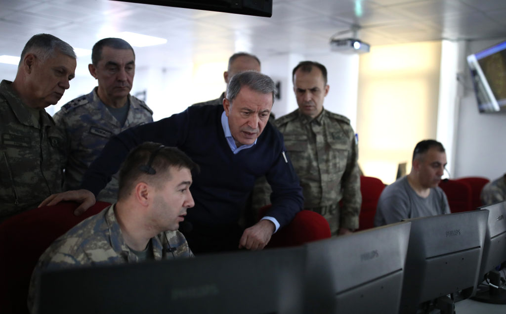Turkish National Defense Minister Hulusi Akar and commanders-in-chief of armed forces inspect the ground and air support units against Assad regime targets in Idlib from a center in Turkey's Hatay province, bordering Syria on Feb. 28, 2020.
