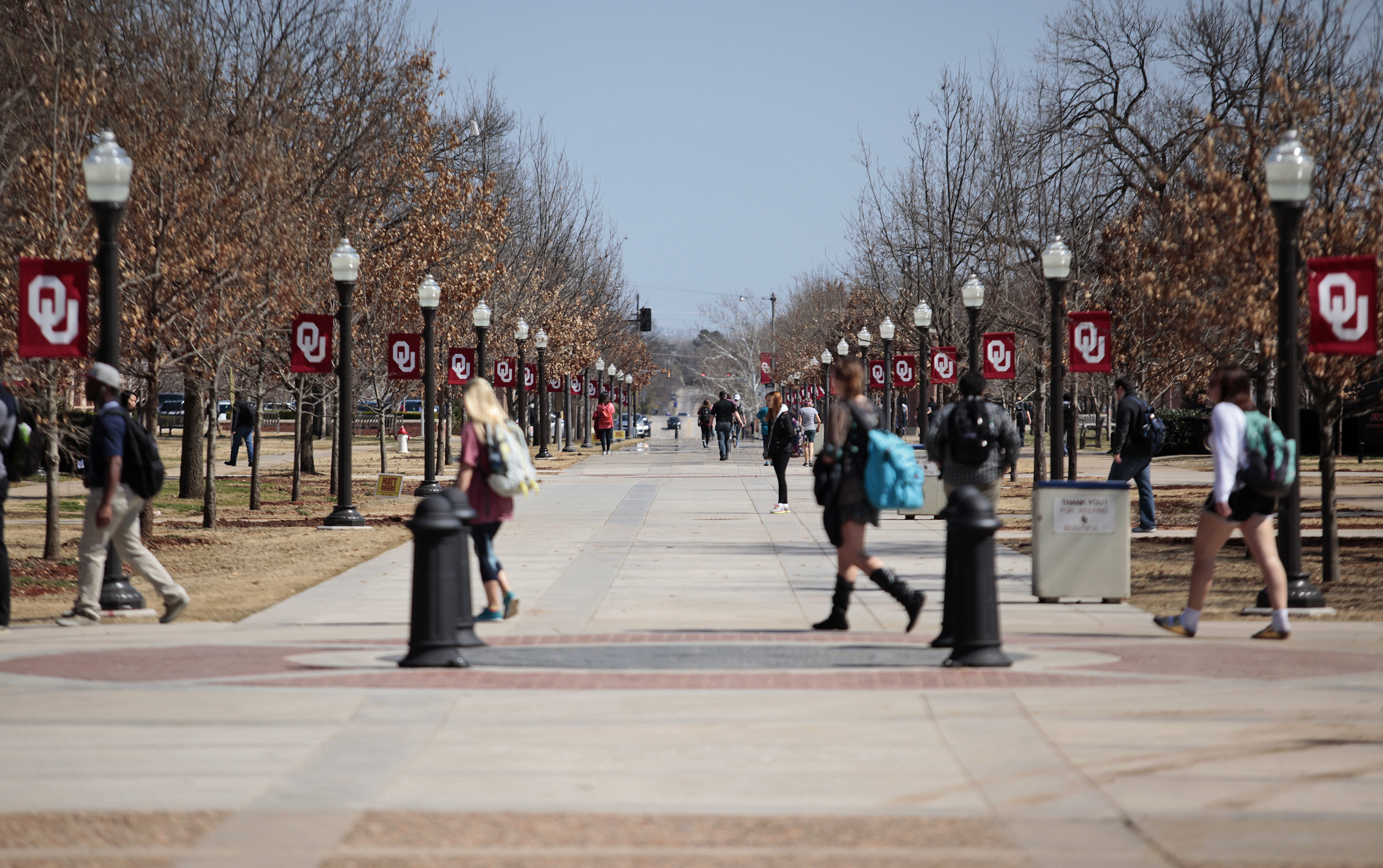 Students walk on campus between classes at the University of Oklahoma on March 11, 2015 in Norman, Oklahoma.