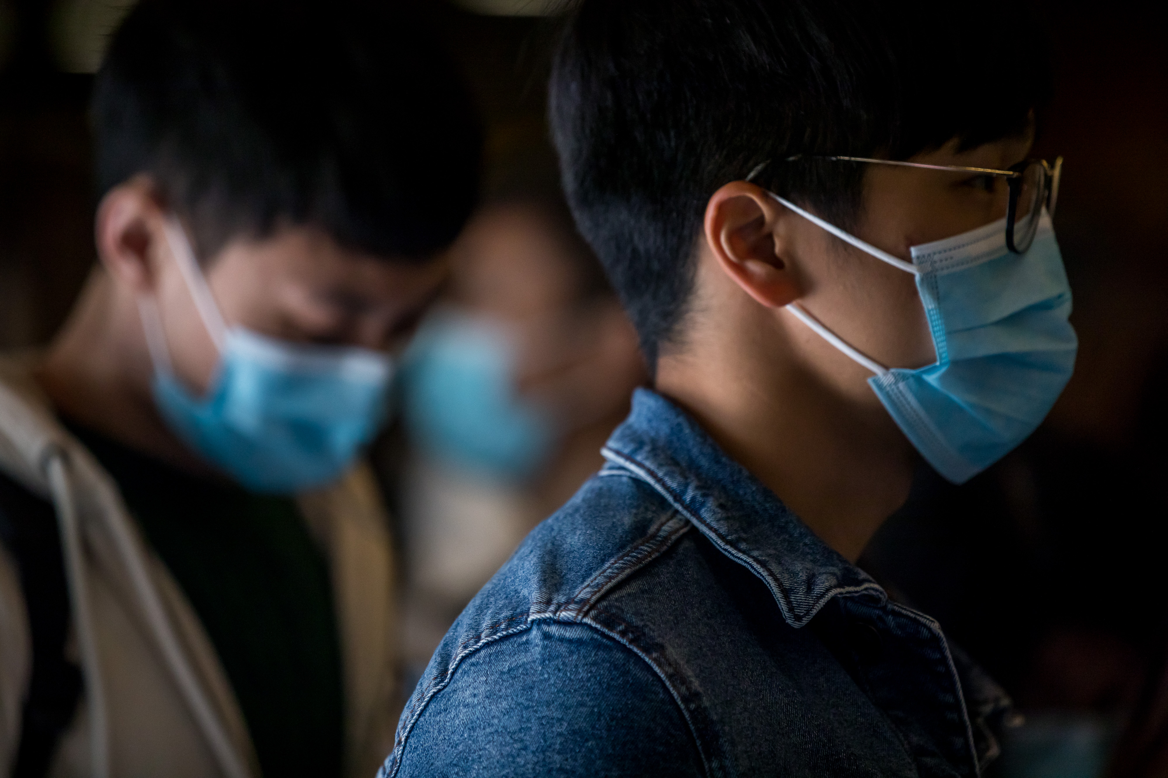 Medical workers wearing protective masks gather during a protest in Hong Kong, on Feb. 4, 2020.