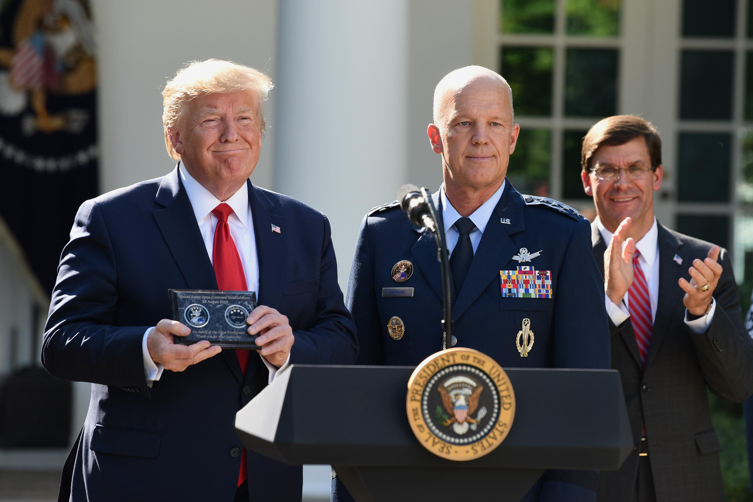 President Donald Trump and General John  Jay  Raymond attend a ceremony marking the establishment the U.S. Space Command at the White House on Aug. 29, 2019.