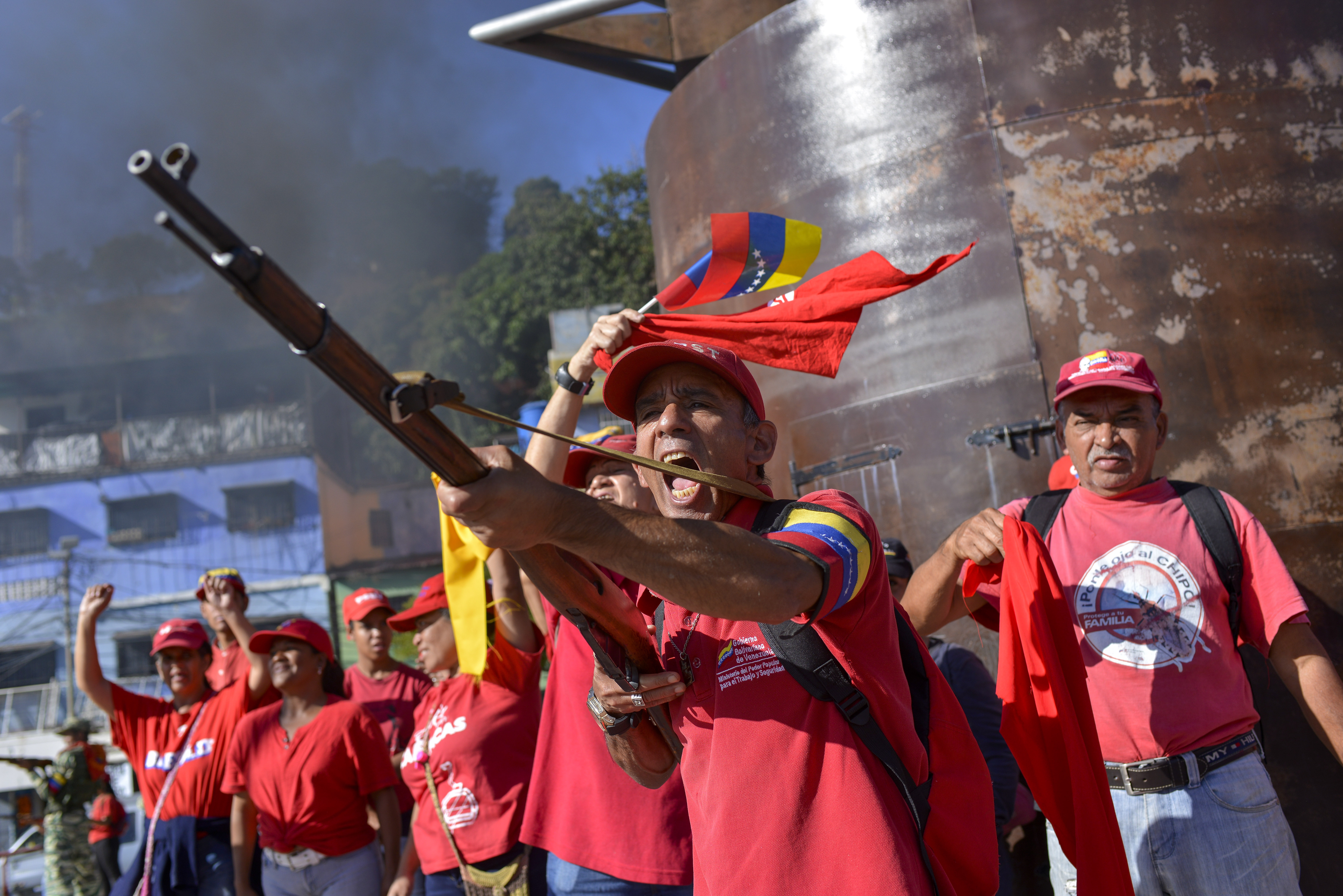 A member of the Bolivarian National Militia brandishes a rifle during an invasion drill in Caracas, Venezuela, on Feb. 15, 2020.