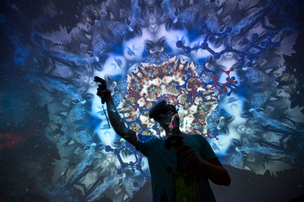 A man tries out a Virtual Reality game inside a Fulldome.pro 360-degree projection dome on opening day of the Electronic Entertainment Expo (E3) at the Los Angeles Convention Center on June 13, 2017 in Los Angeles, California.