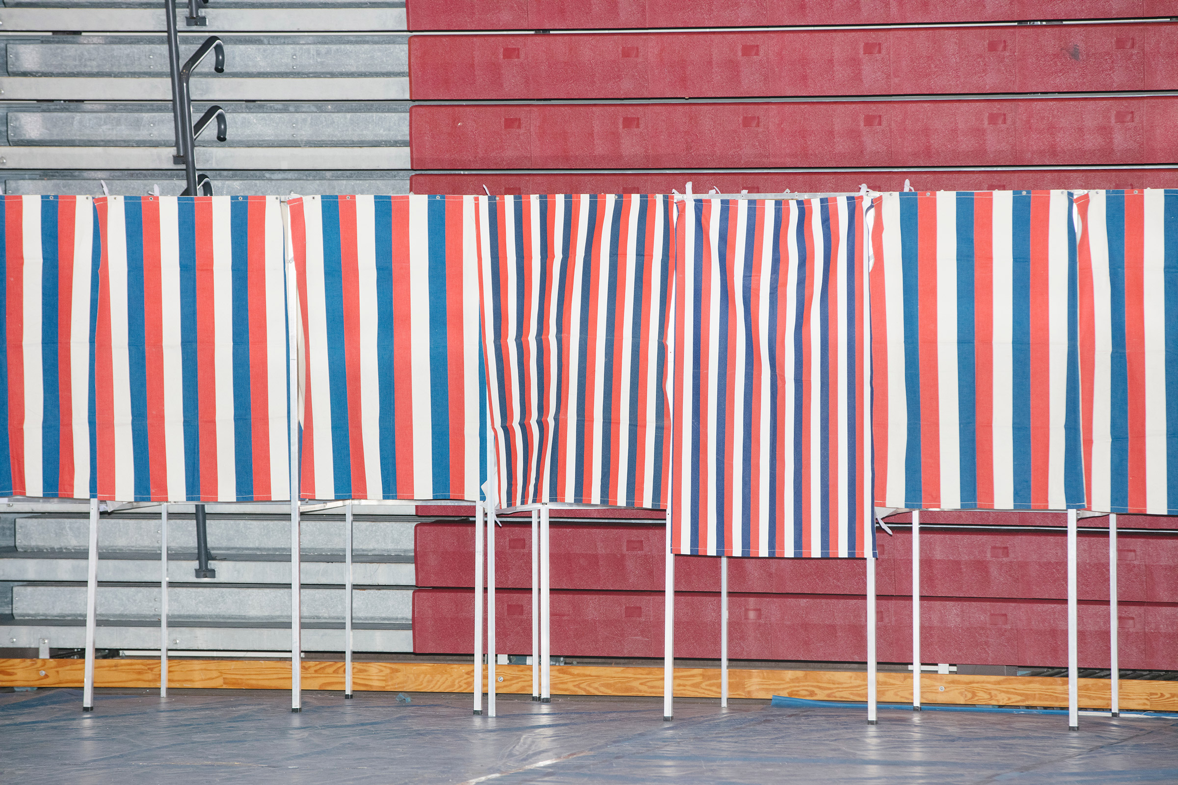 Voting booths stand empty during the New Hampshire Presidential Primary at Bedford High School in Bedford, N.H., on Feb. 11, 2020.