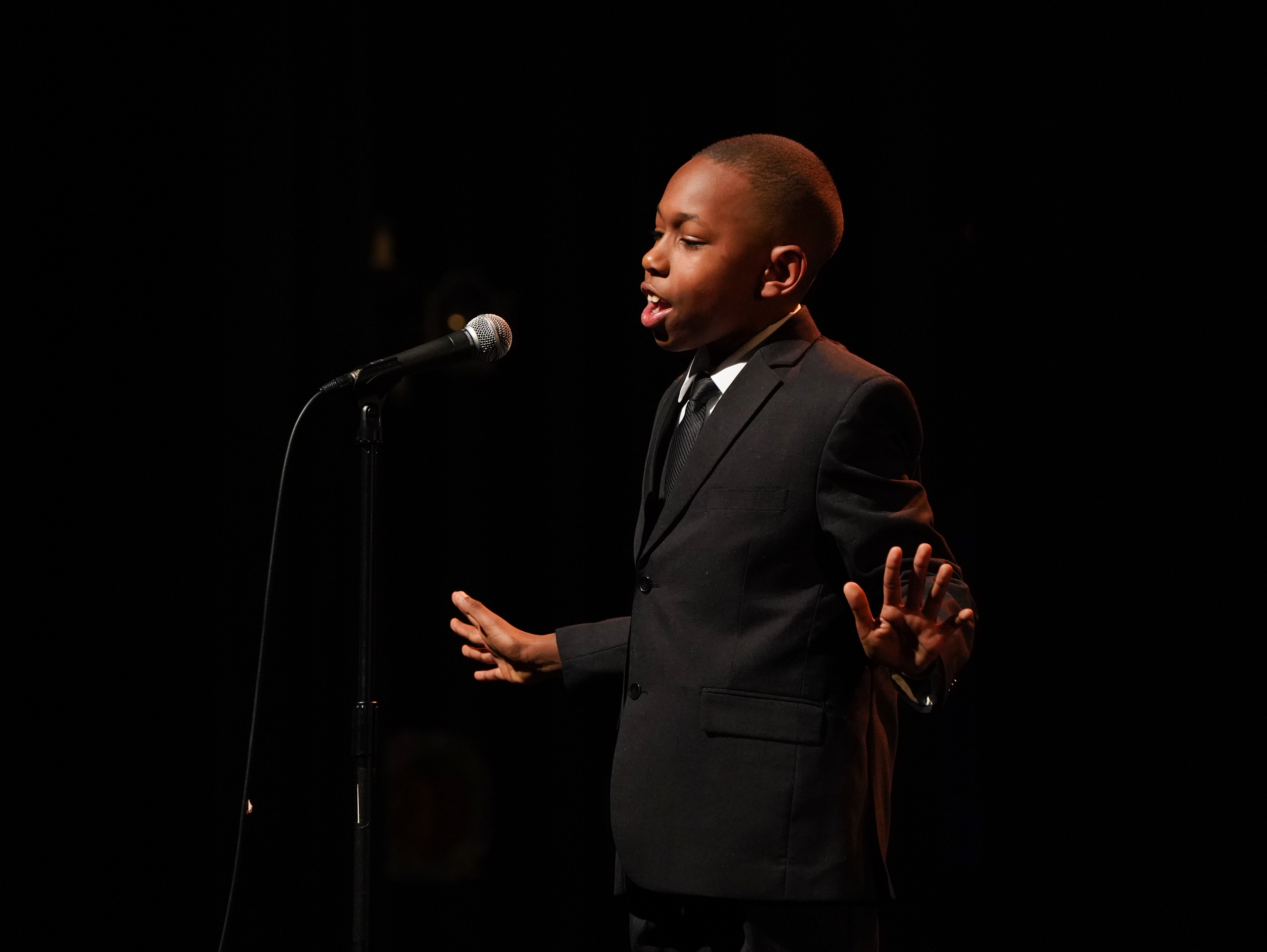 Gregory Payton, 9, delivers a tribute to the Martin Luther King, Jr. speech known as  I've Been to the Mountaintop  (1968) at the 2019 Dr. Martin Luther King, Jr. Oratorical Festival in Oakland, Calif.