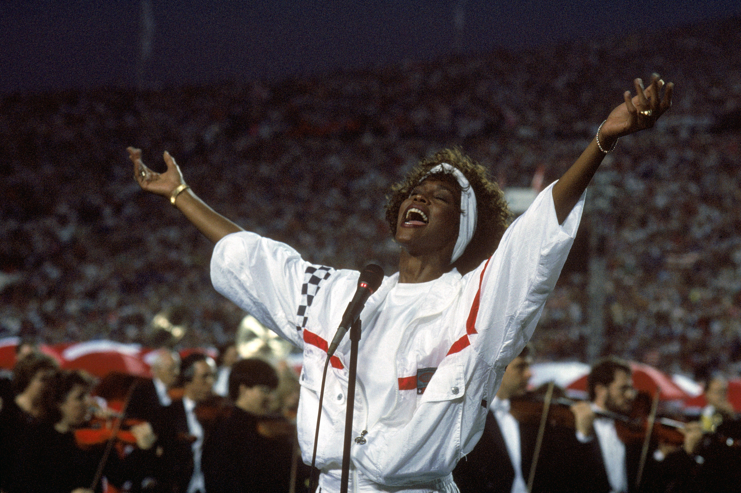 Whitney Houston sings the National Anthem before a game with the New York Giants taking on the Buffalo Bills prior to Super Bowl XXV at Tampa Stadium on Jan. 27, 1991 in Tampa, Fla.