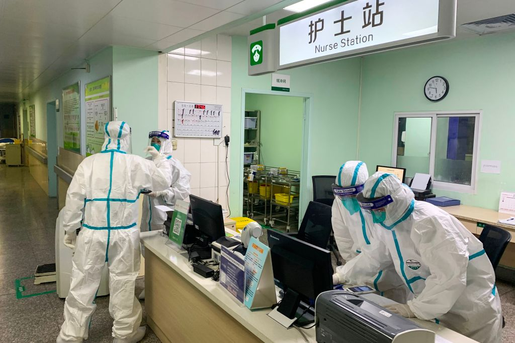 This photo taken on Jan. 22, 2020 shows medical staff members wearing protective suits at the Zhongnan hospital in Wuhan in China's central Hubei province.