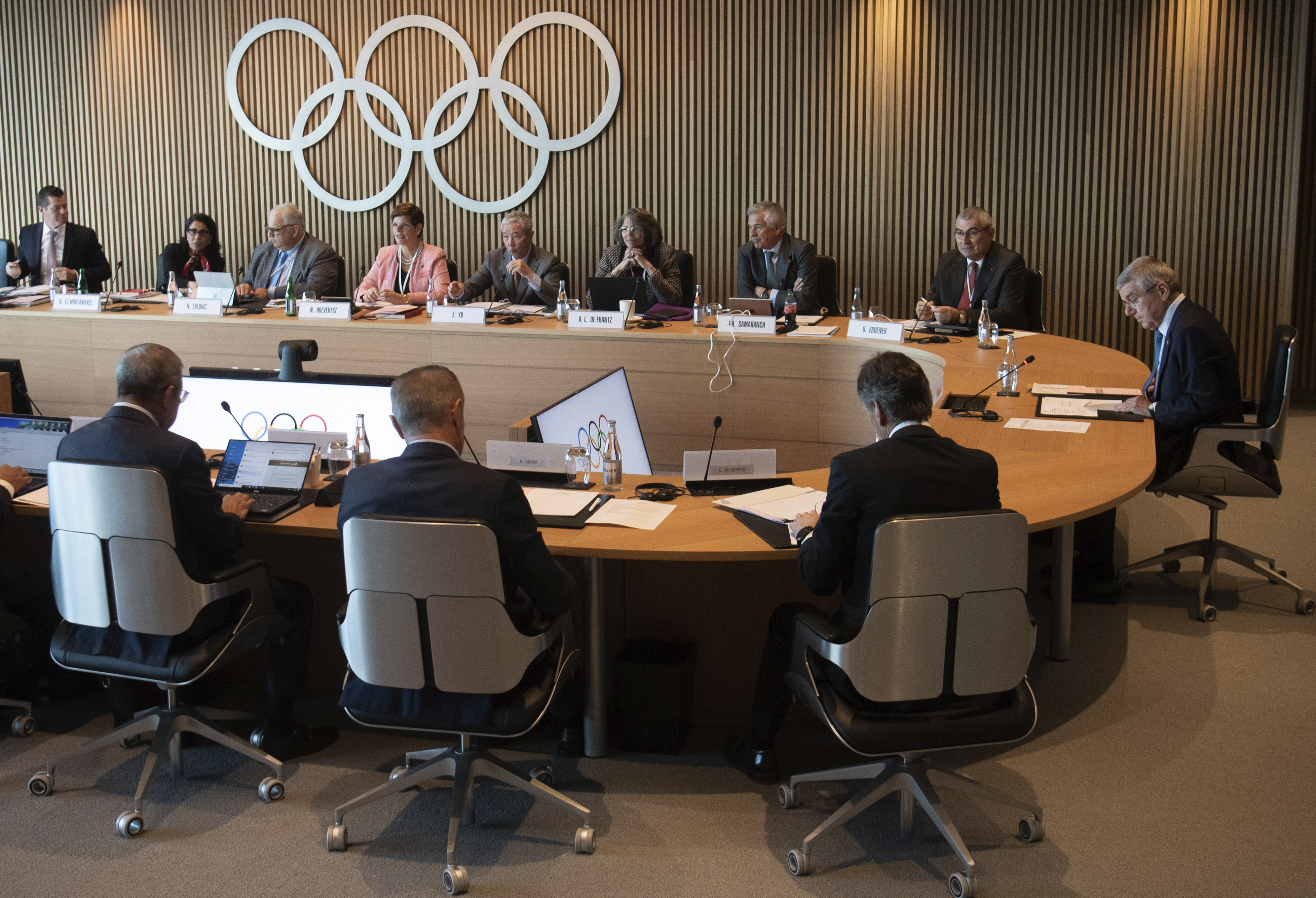 International Olympic Committee (IOC) president Thomas Bach, right, from Germany attends the opening of the executive board meeting of the International Olympic Committee (IOC) at the Olympic House in Lausanne, Switzerland, on March 3, 2020.