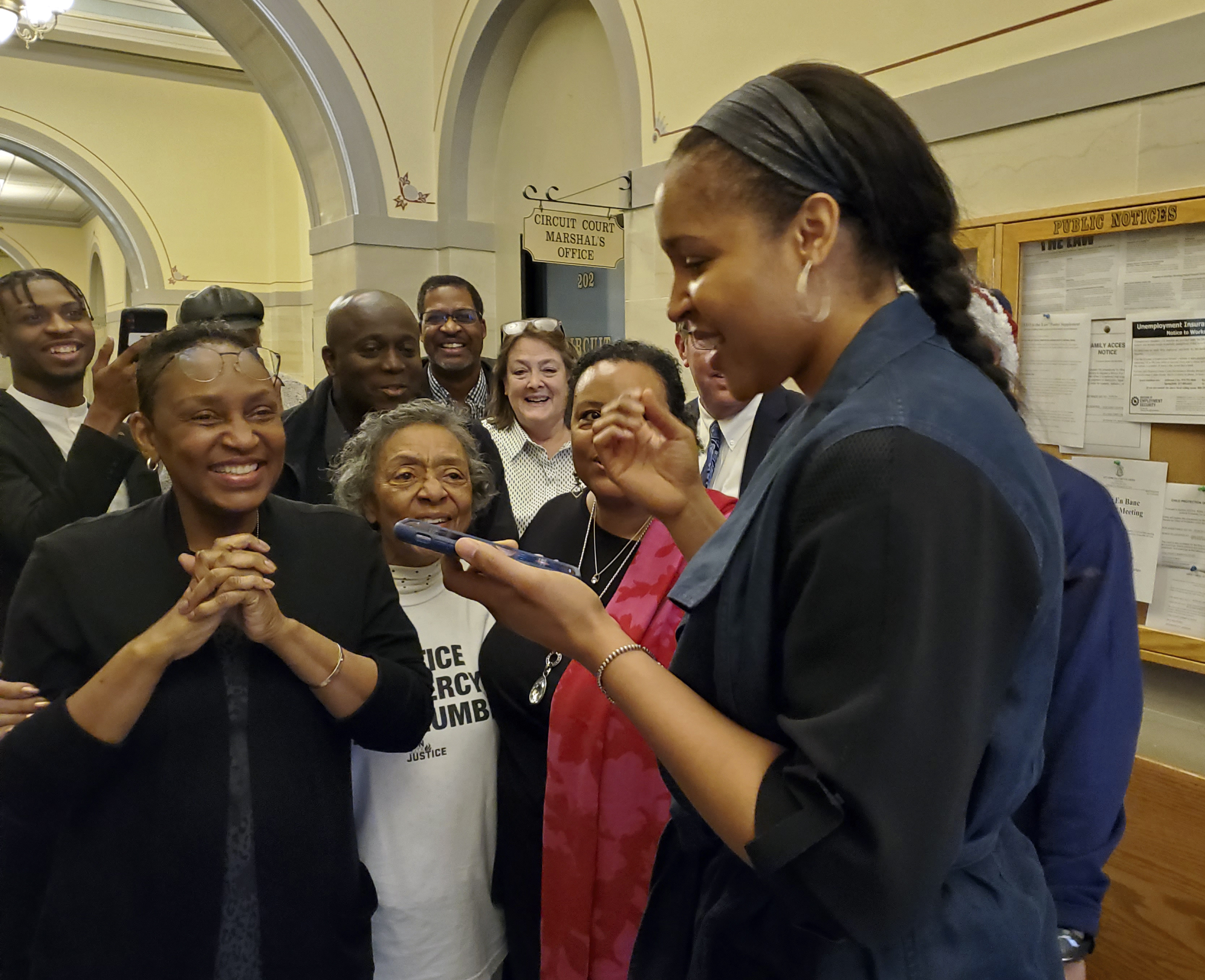 Jefferson City, Mo., native and WNBA star Maya Moore, right, calls Jonathan Irons as supporters react Monday, March 9, 2020, in Jefferson City after Cole County Judge Dan Green overturned Irons' convictions in a 1997 burglary and assault case. Moore, a family friend, had supported Irons, sharing his story on a national basis.